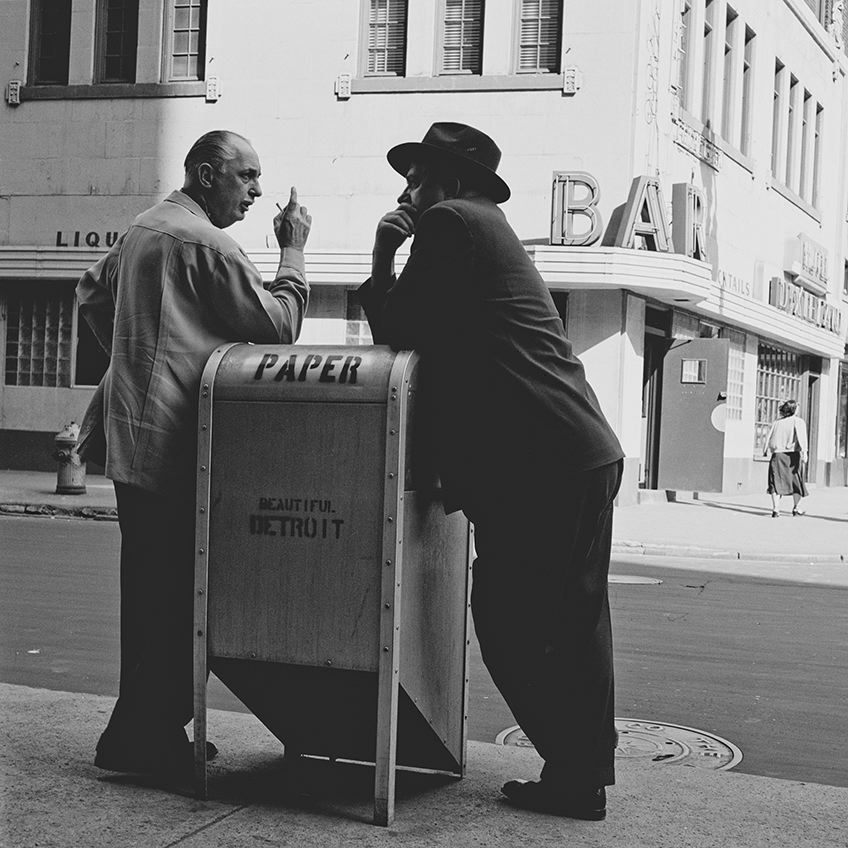 photograph of two men talking over a mailbox by bill rauhauser