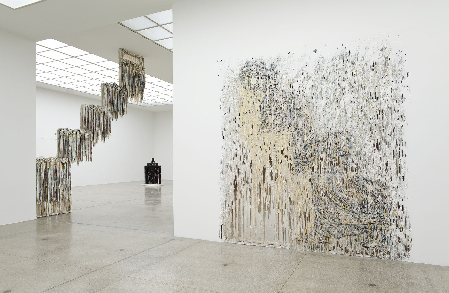 an exhibition view of sculptures and artworks by Diana Al-Hadid in a museum