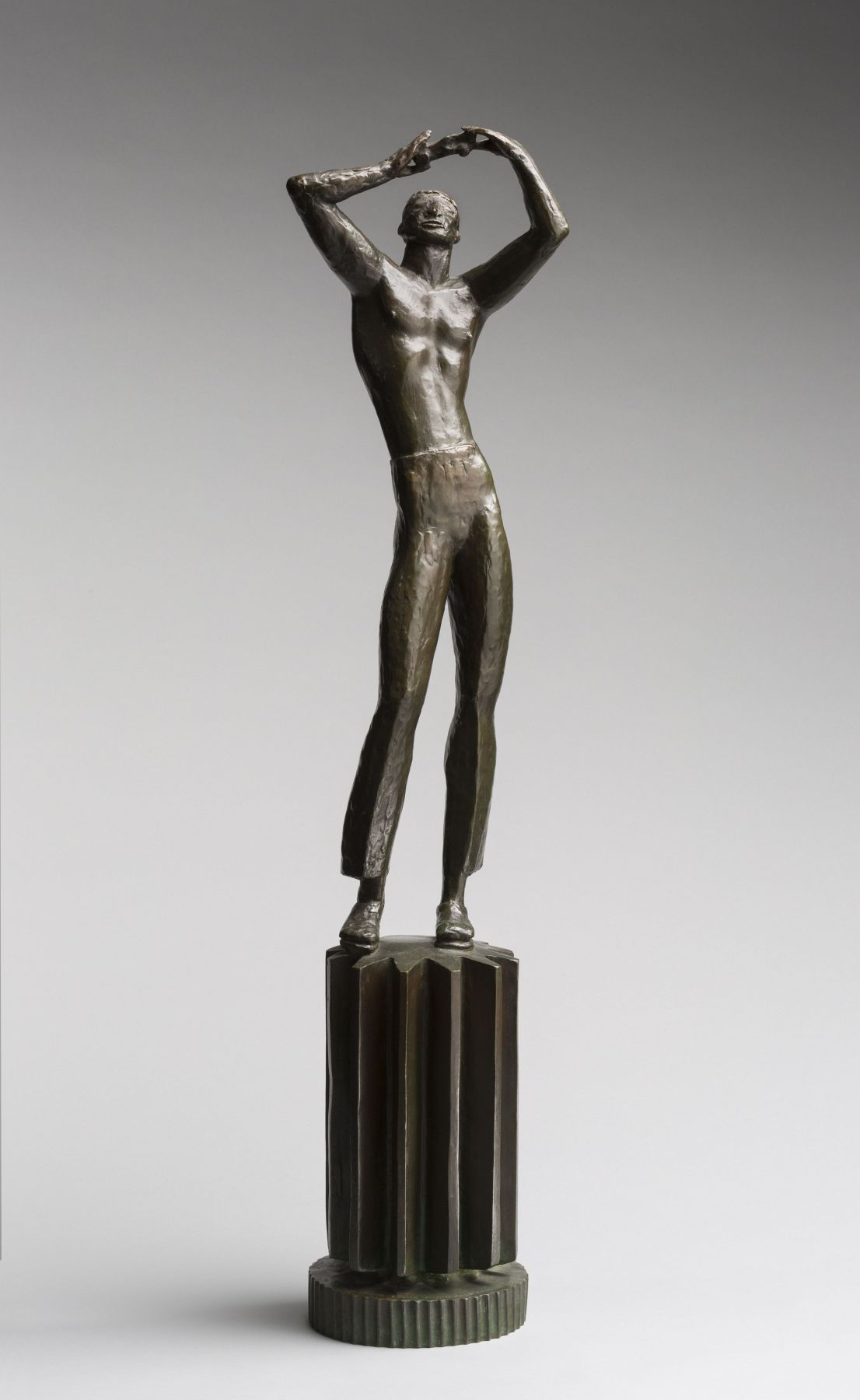 bronze sculpture of a man with arms raised over head by carl milles