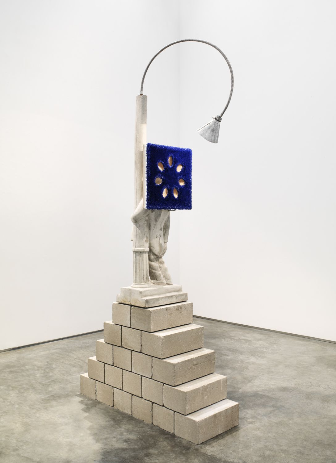 donald moffett's sculptural artworks featuring a painting on a lamp and concrete base