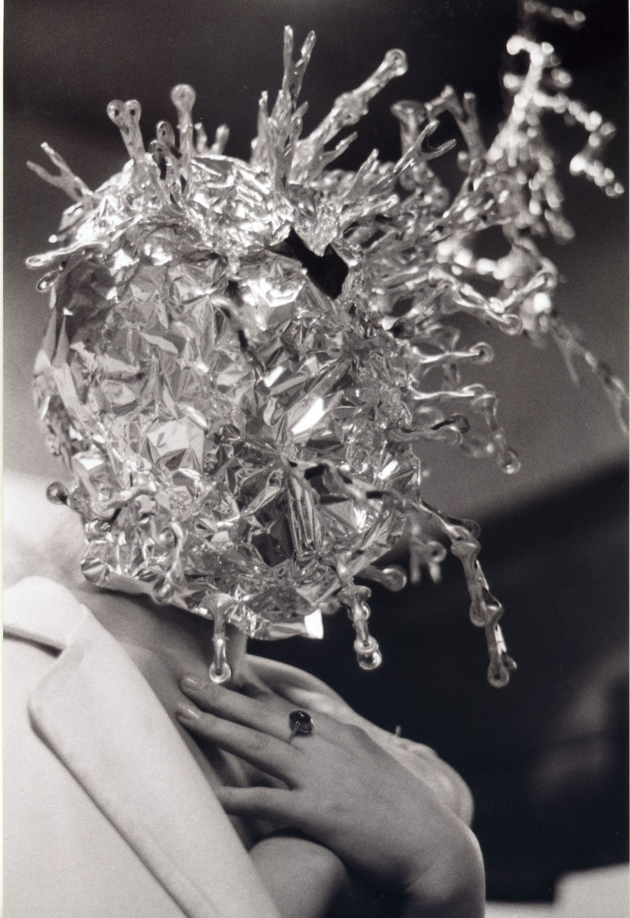 photograph of a woman with crystals covering her head by minoru hirata