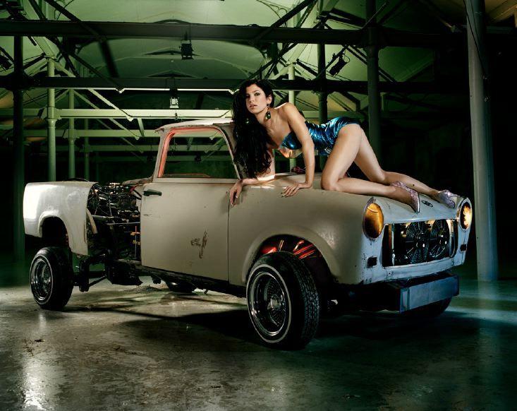 photograph of a woman on a car hood by liz cohen