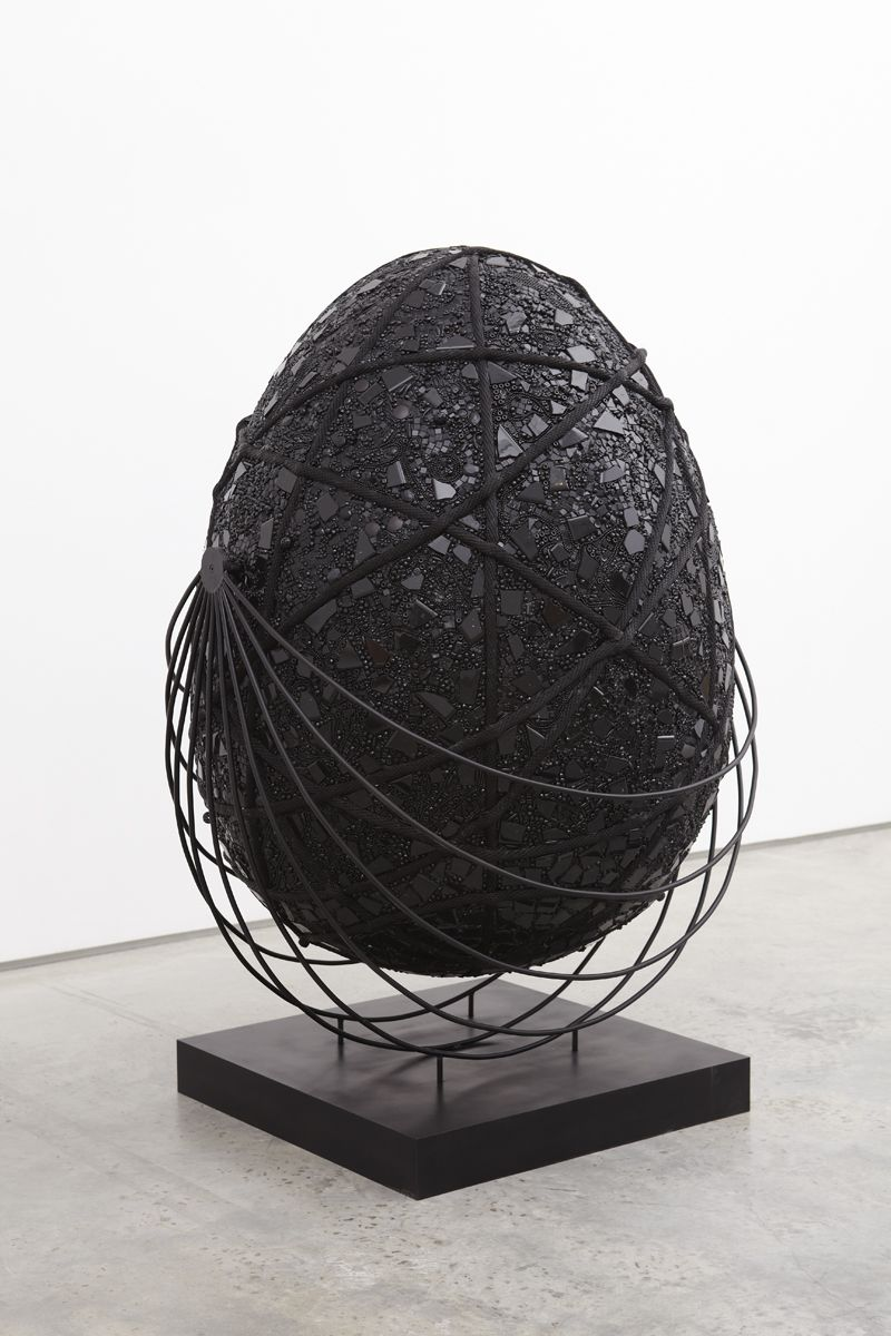 black egg shaped sculpture by mindy shapero