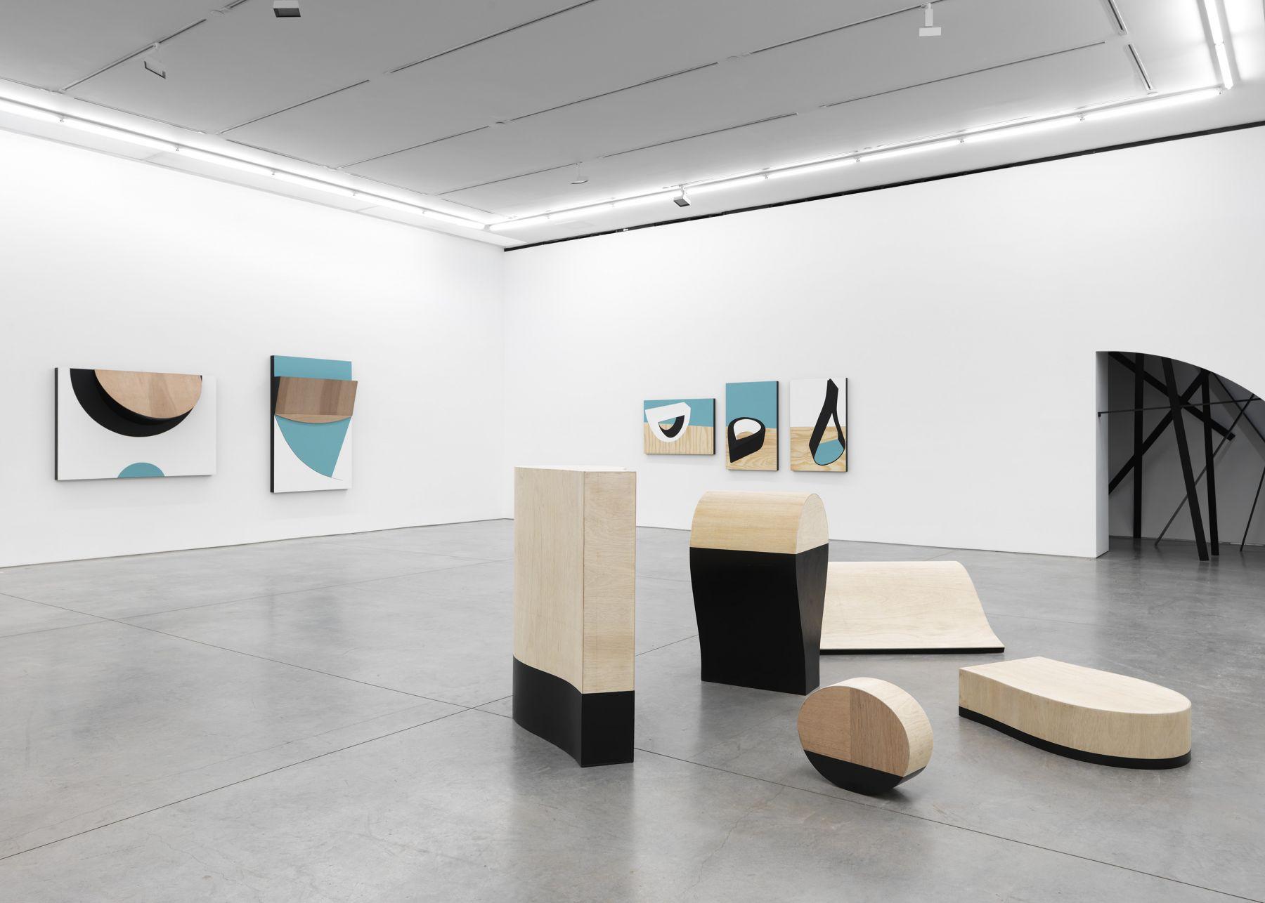 sculpture and artwork by serge alain nitegeka in a gallery