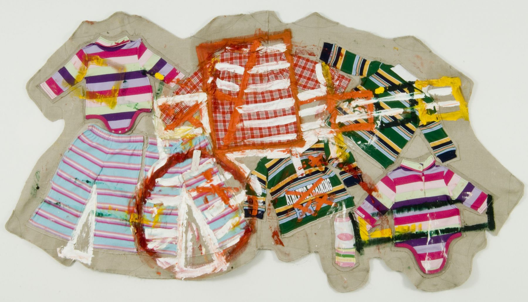 mixed media installation featuring baby clothes by mike cloud