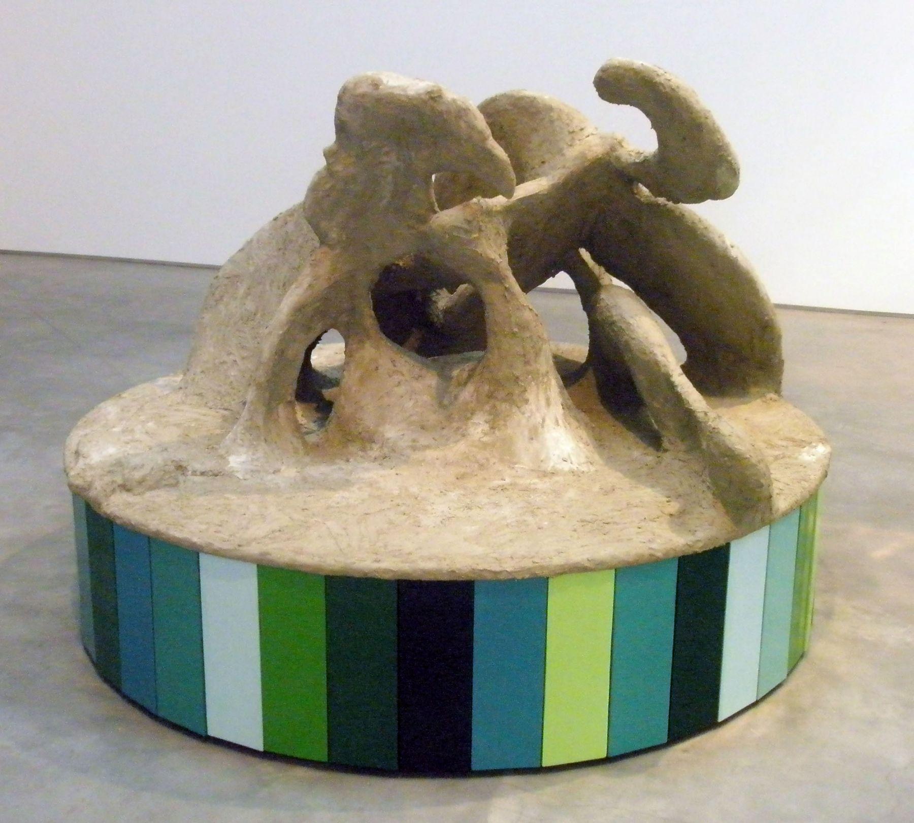 circular blue, green, and concrete sculpture by rachel feinstein