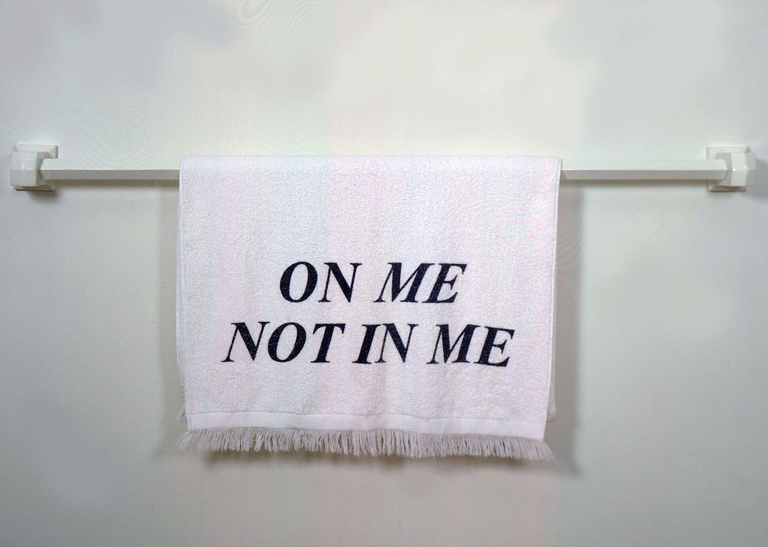 """towel on rack with """"on me not in me"""""""