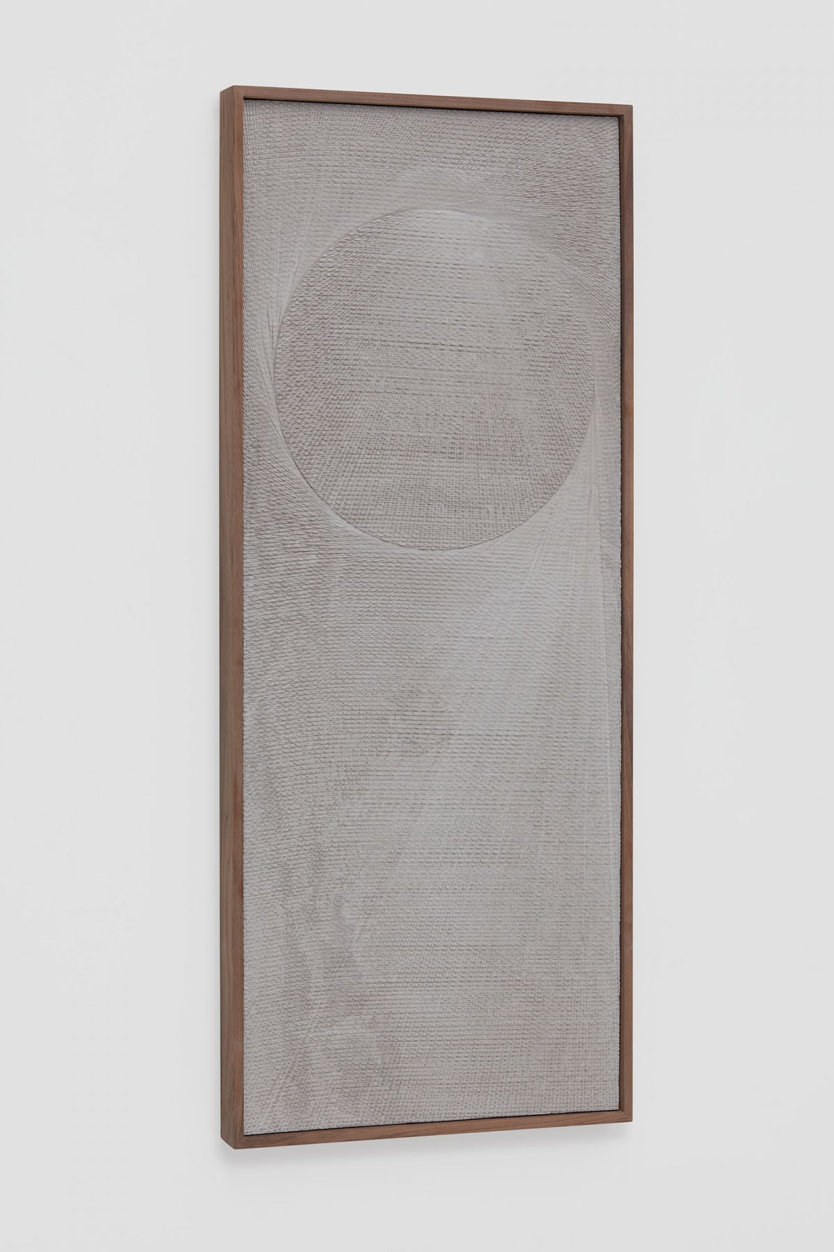 an angled view of an etched plaster work by anthony pearson, a contemporary artist