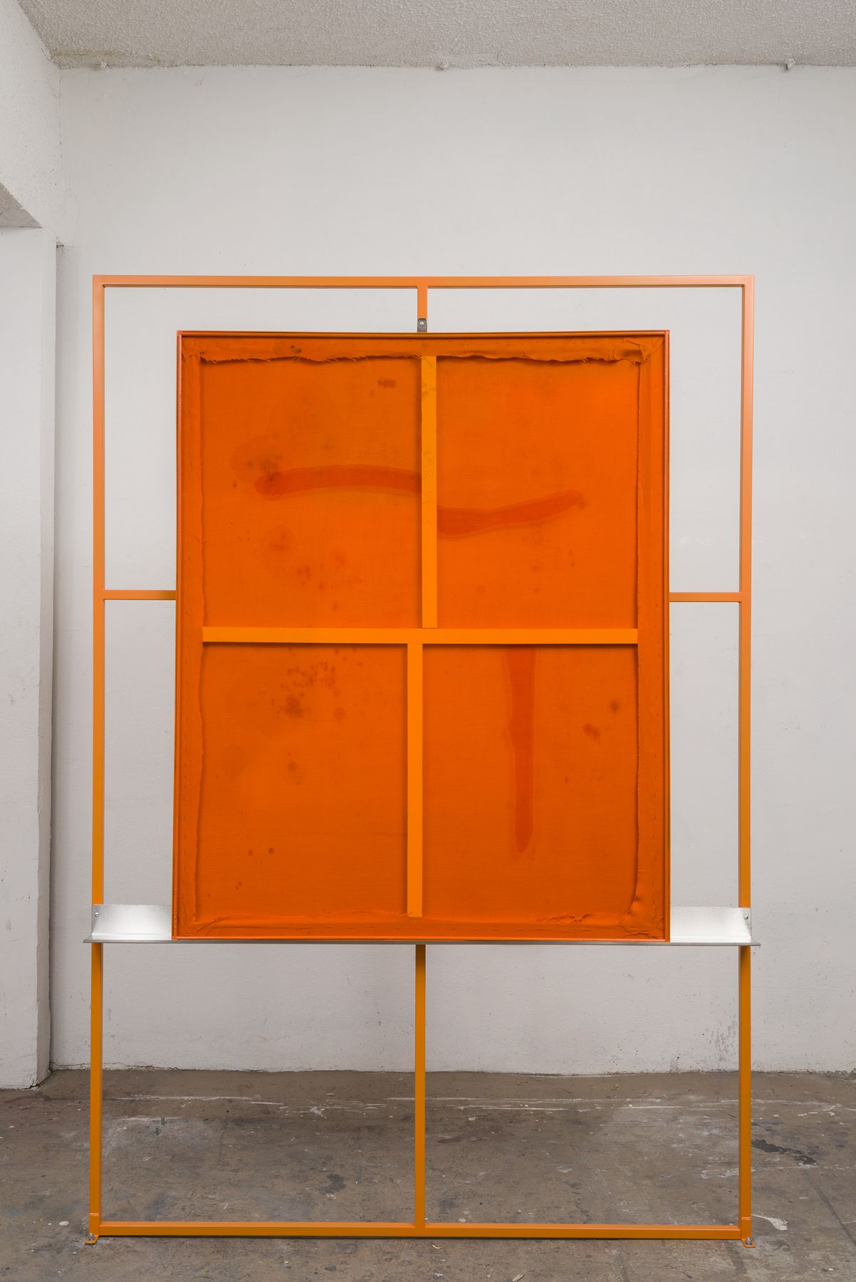 the other side of the sculptural artwork by dashiell manley in a bright orange