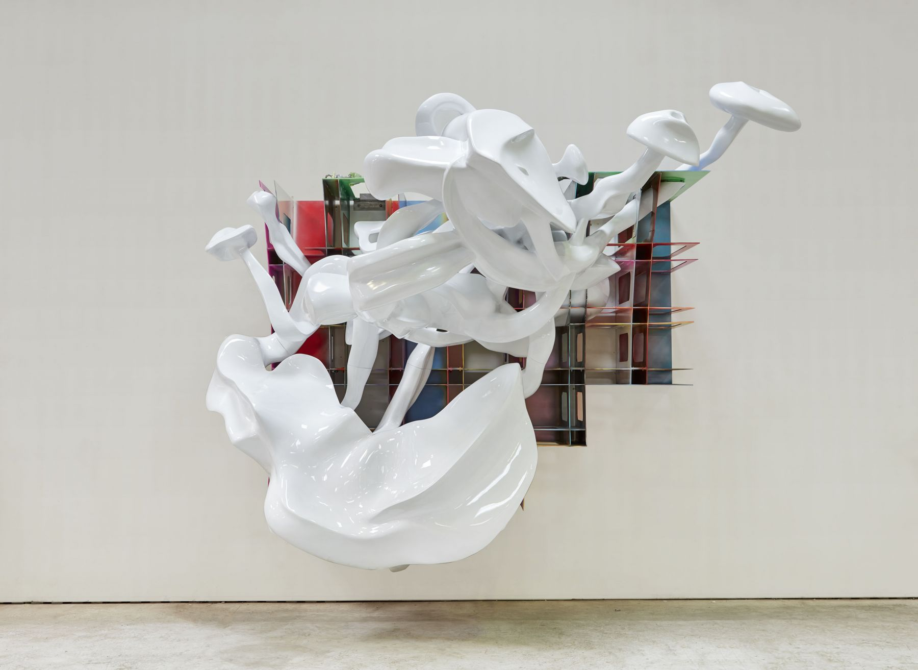 a large sculpture with smoke rings by frank stella