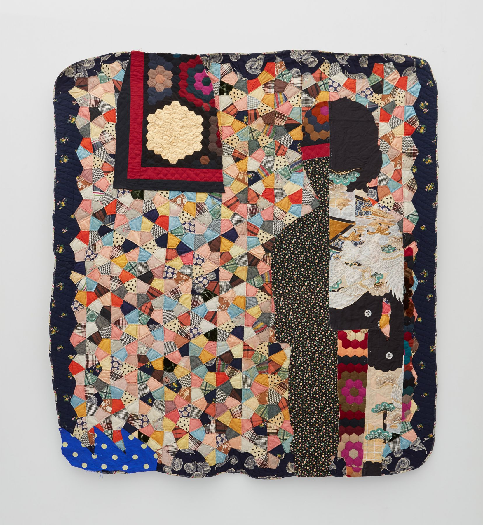 a contemporary quilt made out of antique quilt fragments by Sanford Biggers