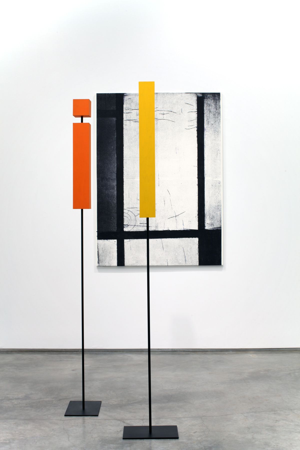 installation by melissa gordon with black and white grid painting and yellow and red rectangular sculptures
