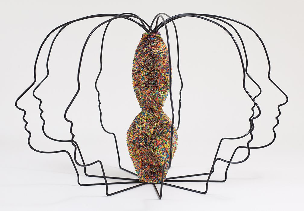 wire sculpture by mindy shapero with eight attached heads