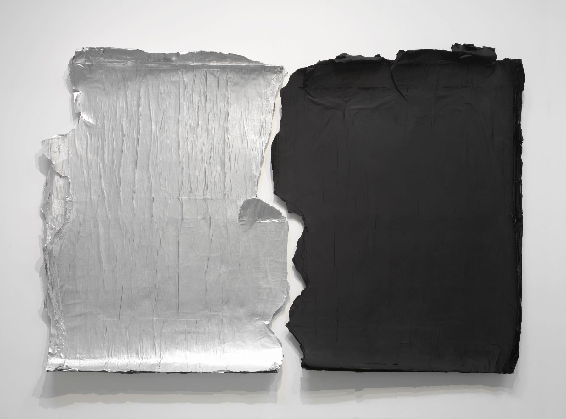 silver and black panels peeling off the wall by jeroen jongeleen