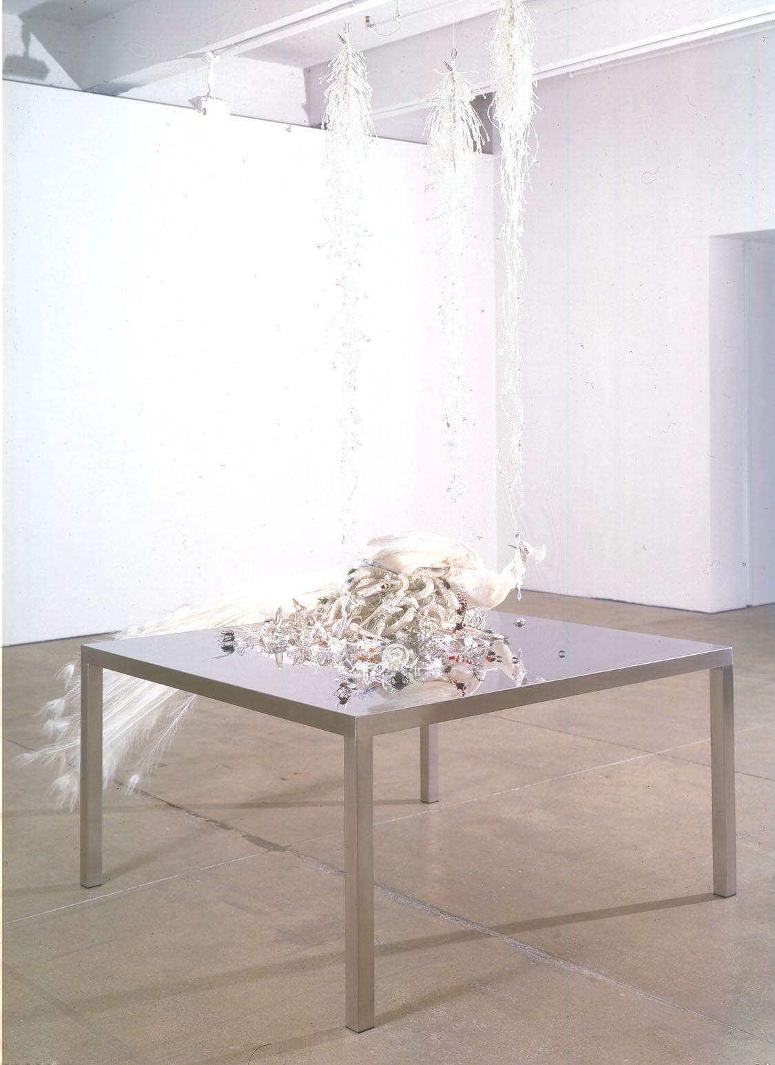 table with crystals and quartz by angelo filomeno