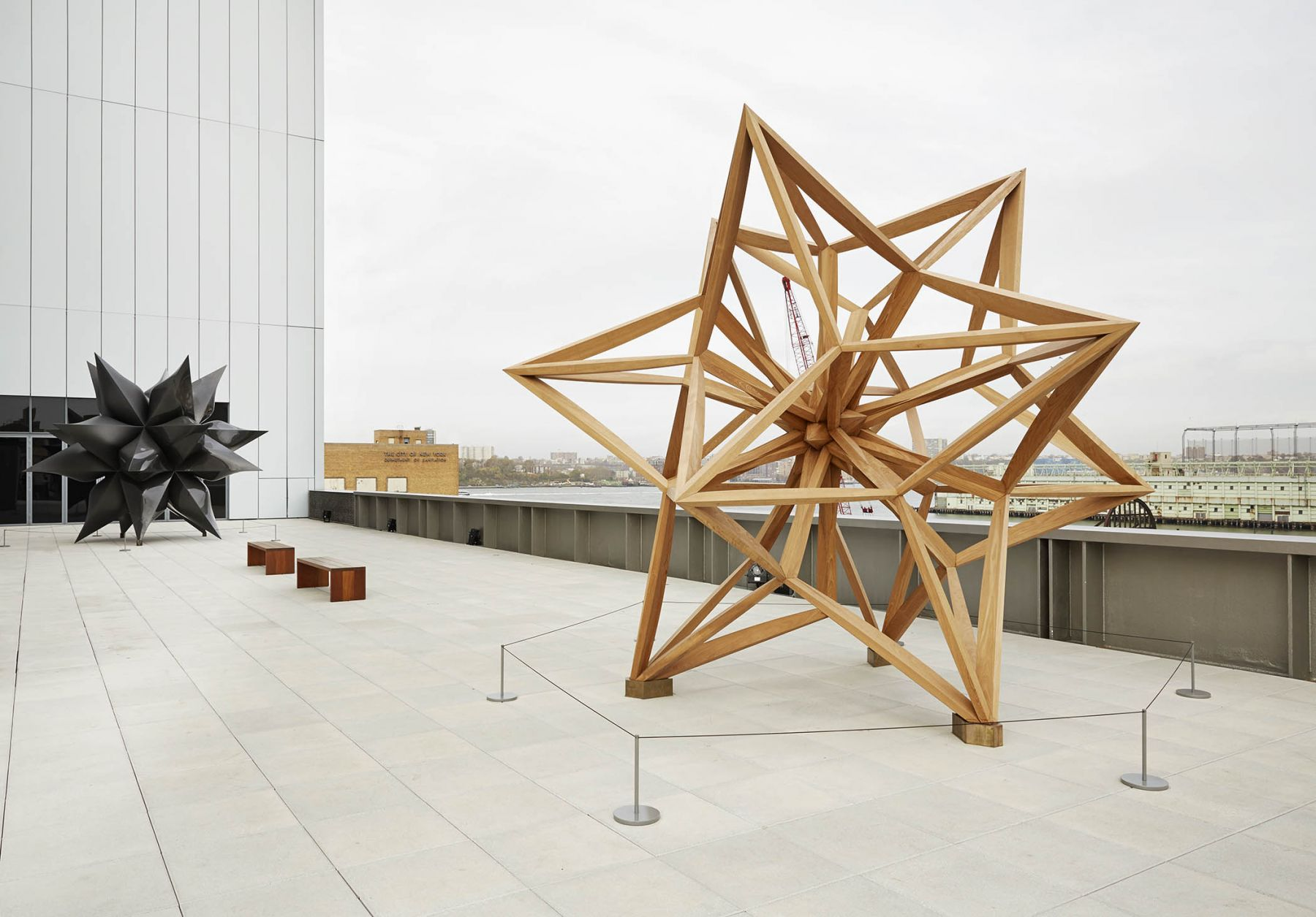 A wooden star by frank stella on a rooftop of the whitney museum of art