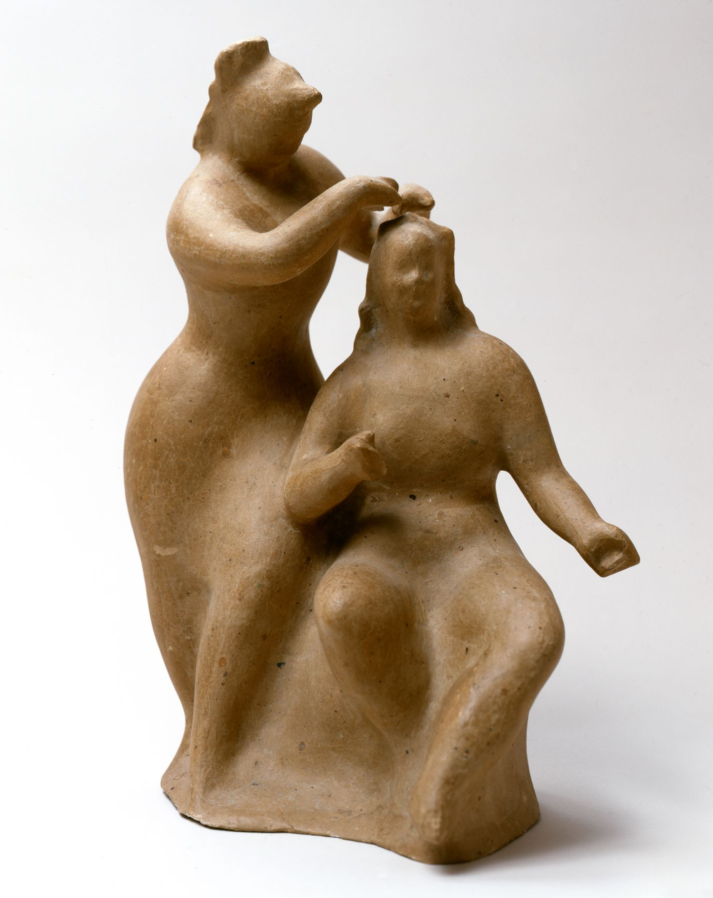 elie nadelman, Woman Dressing Another Woman's Hair, 1930's, cast papier-mâché, 14 1/2 inches high