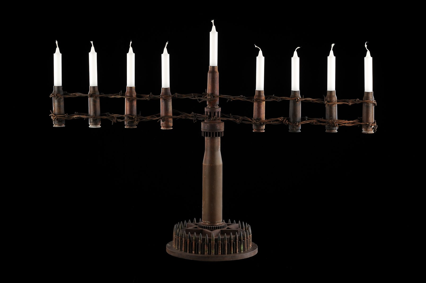 Al Farrow, Menorah (Fence II), 2011, shell casings, barbed wire, steel, 23 x 32 x 10 inches