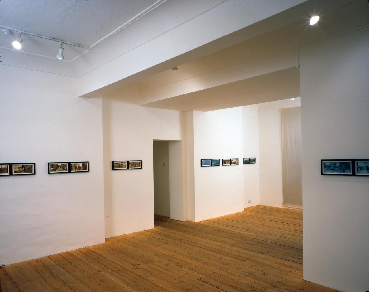 Installation view, Boris Mikhailov: 'By the Ground' and 'At Dusk'.  London Projects, London, March 7 - April 12, 1997