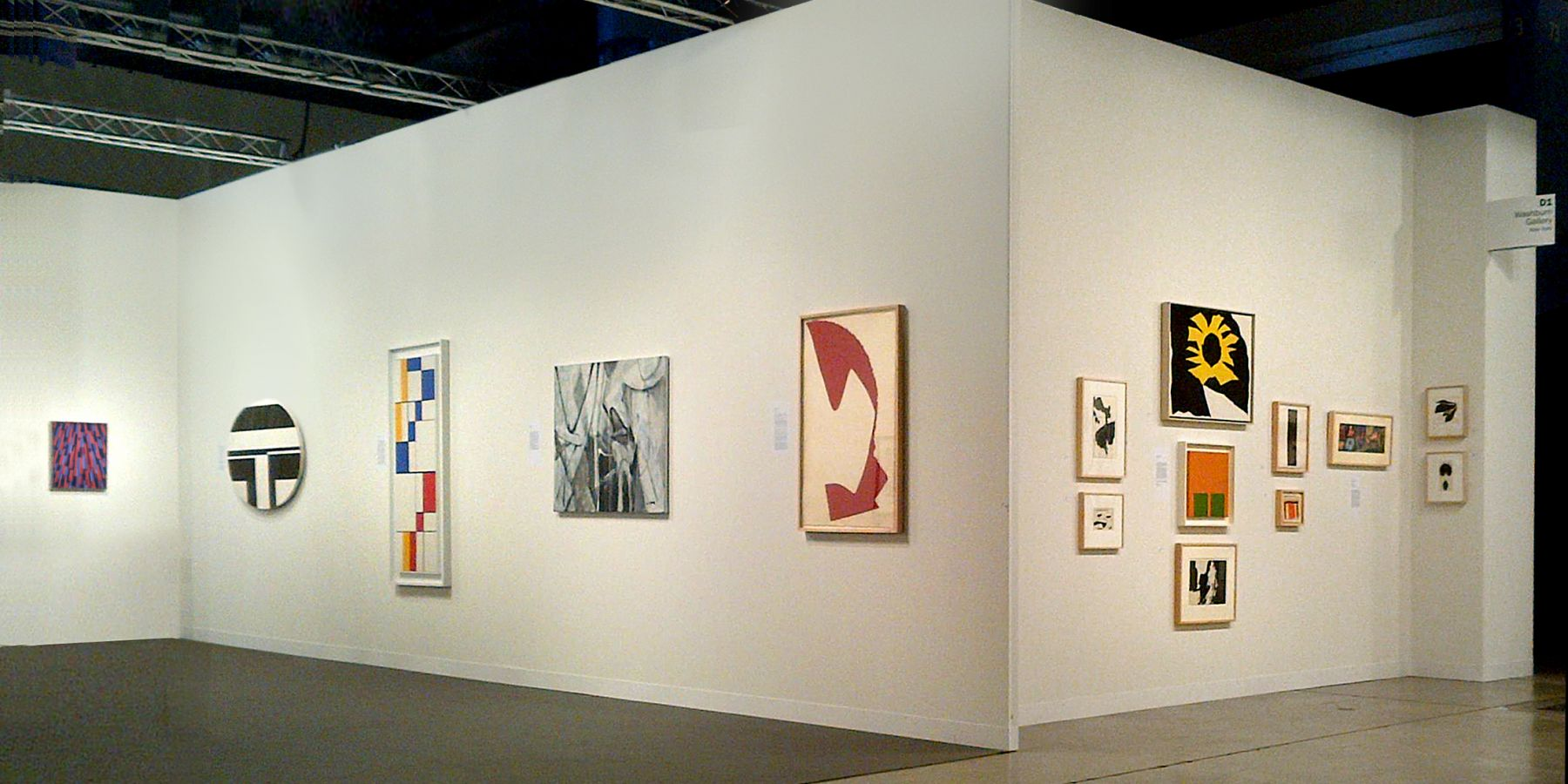 "(from left) Myron Stout, Untitled, c. 1950, oil on canvasboard, 20 x 16 in., Ilya Bolotowsky, ""Black and White Ellipse, 1963, oil on canvas, 30 x 40 in., Leon Polk Smith, ""Diagonal Passage: Red-Blue-Yellow,"" 1949, oil on canvas, 54 x 20 in., Nicolas Carone, ""Off the Chart,"" 2009, acrylic on tarpaulin, 33 x 42 in., Leon Polk Smith, Untitled, 1964, torn paper drawing, 39 x 25 in., (right wall) Small works by Nicolas Carone, Reuben Kadish, Alice Trumbull Mason, Doug Ohlson, Ray Parker, Leon Polk Smith, Richard Stankieiwcz, and Jack Youngerman"