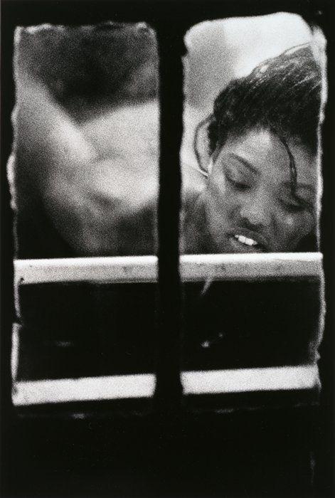 Woman in window by Merry Alpern