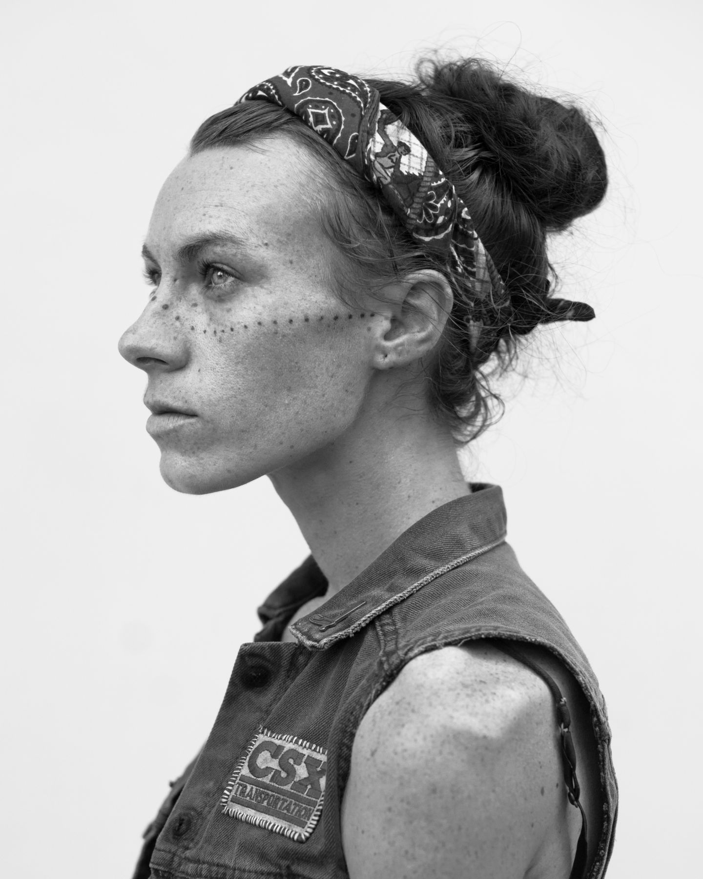 Woman with bandana and face tattoo by Michael Joseph