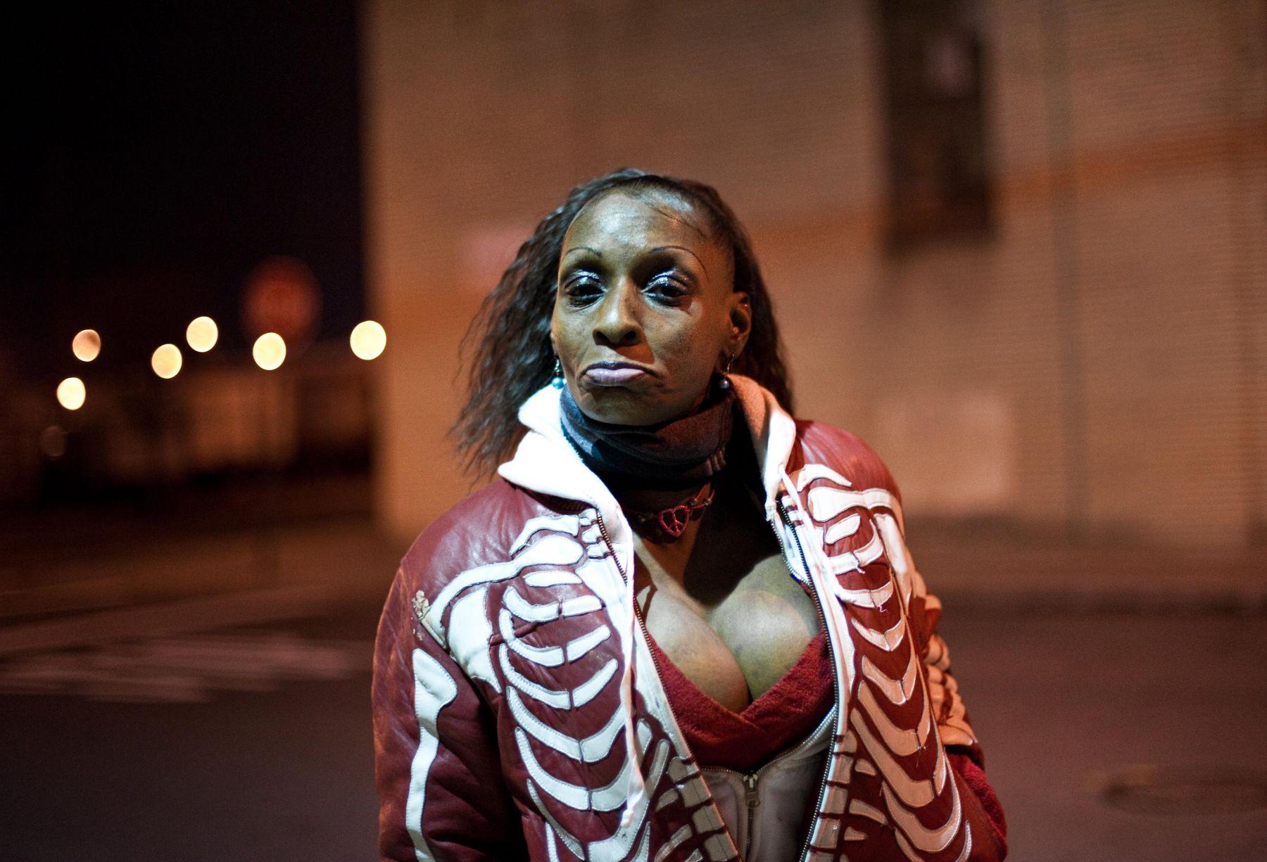 Woman at night by Chris Arnade