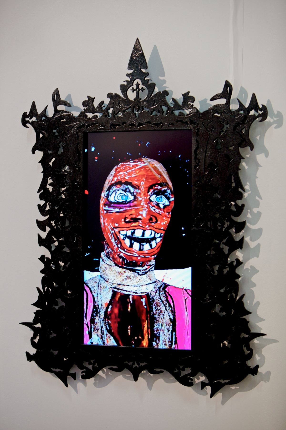 FEDERICO SOLMI_Dick Richman, Portrait of a Scam Artist  2011, video-animation with artist-designed frame and LCD panel, 45 x 30 inches