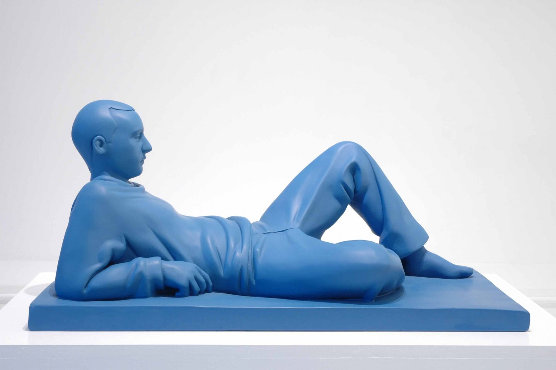 Kenny Hunter Reclining Man glass reinforced plastic and paint, 4 x 30 x 13.5 inches sculpture