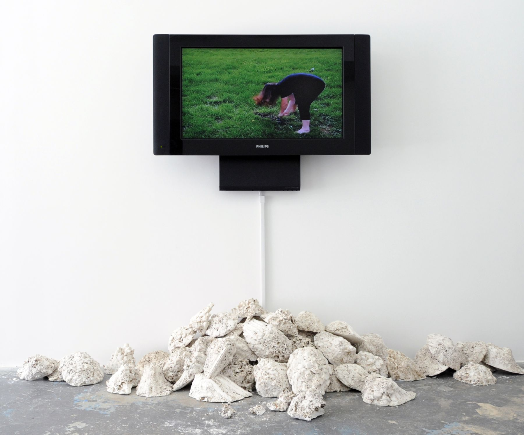CAROLINE COVINGTON Beatings: Baltimore 2011, performance and installation with cast plaster, video, dirt, 84 x 120 x 36 inches. Installation view: ACADEMY 2011, Conner Contemporary Art.