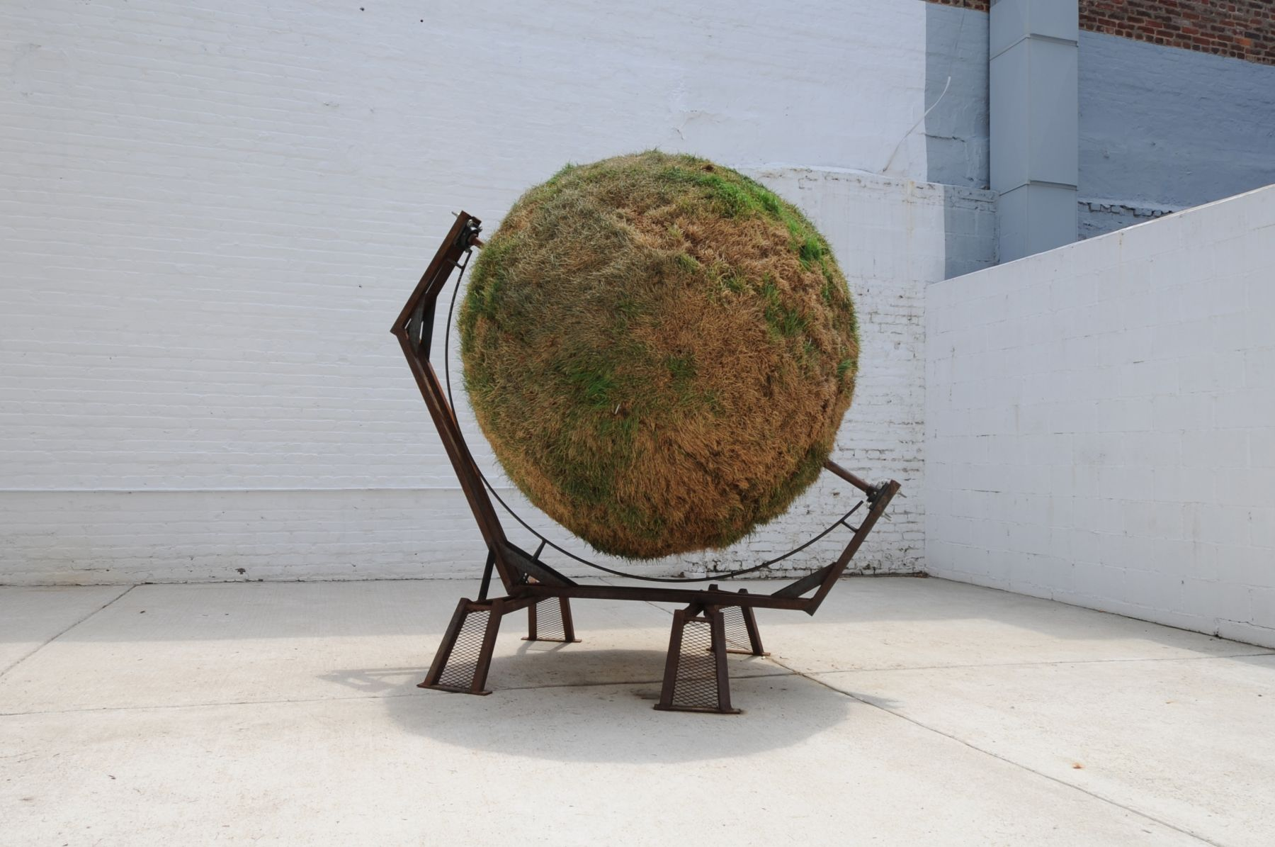 DAN GIOIA Sphere 2011, sod and steel, 84 x 84 x 60 inches. Installation view: ACADEMY 2011, Conner Contemporary Art.