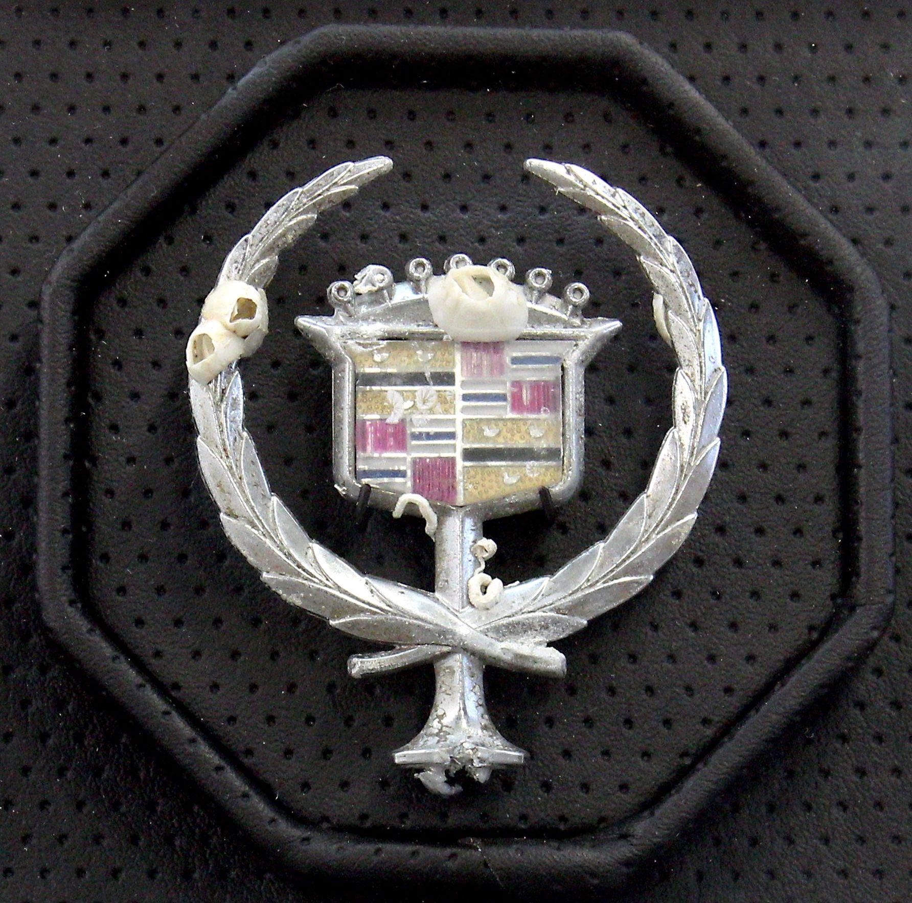Benjamin Kelley Untitled 07, 2019 Vinyl, acrylic, valcromat, barnacle encrusted Cadillac emblem 6.25 x 6.25 x 6 inches