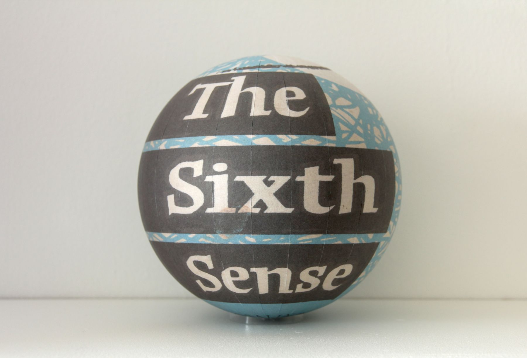 SUSAN MACWILLIAM  The Sixth Sense  2013/2014, inkjet paper, plastic sphere, 6 x 6 x 6 inches