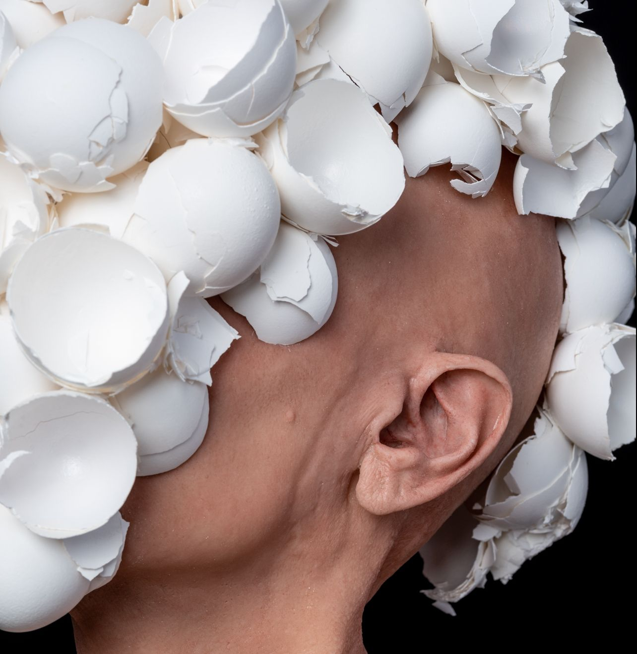 J.J. McCracken, The Feeding, 2020, painted platinum silicone lifecast, eggshells, ceramic, 22 x 16 x 12 inches.