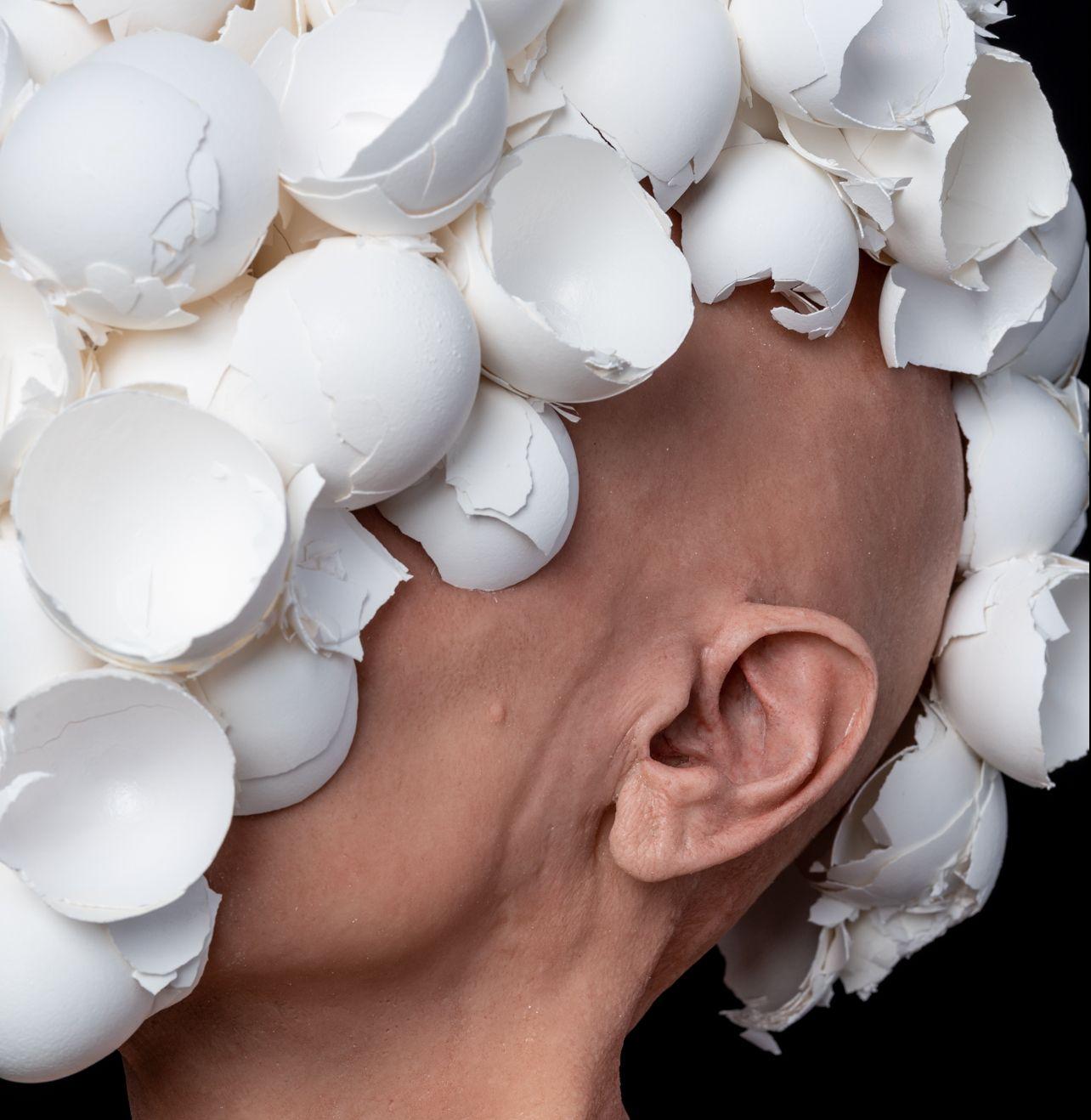 J.J. McCracken, The Feeding, 2020, painted platinum silicone lifecast, eggshells, ceramic, 22 x 16 x 12 inches.
