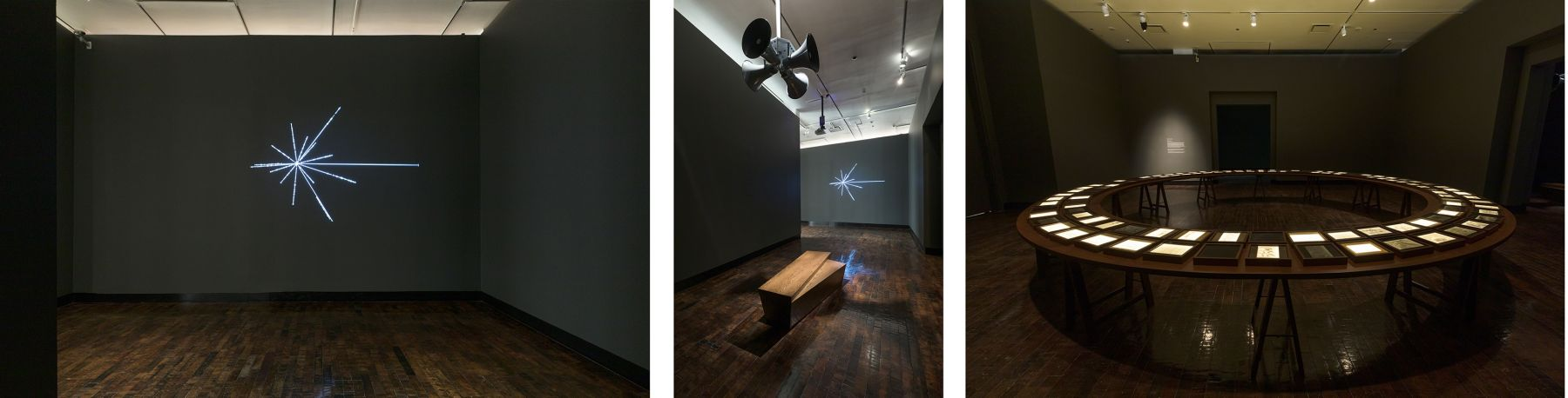 Three installation views of the artwork at the Frist Art Museum. From left to right: an image of the solar location map sculpture, vertical beams of light hanging from ceiling, an image of a bench below a four-horned speaker, and an image of a round wood table with documents placed on top.