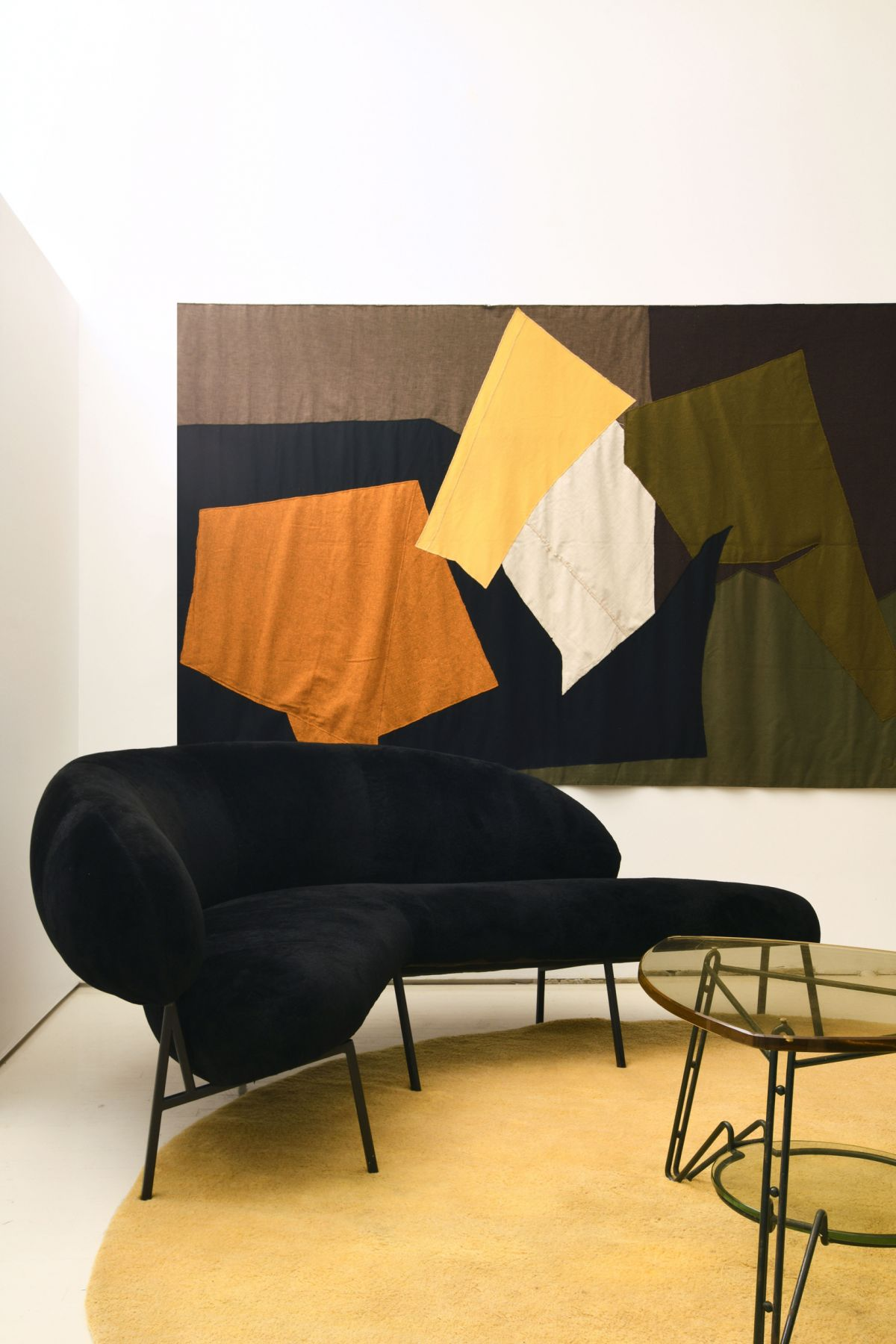 Michael Bargo's pace - installation image including sofa by Pierre Szekely, tapestry by Claude Stahly and italian coffee table in metal and glass.