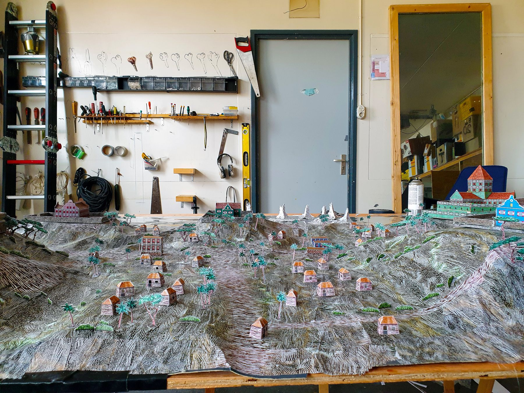 "Inside de Beijer's studio, building the model set for ""Bastion""."