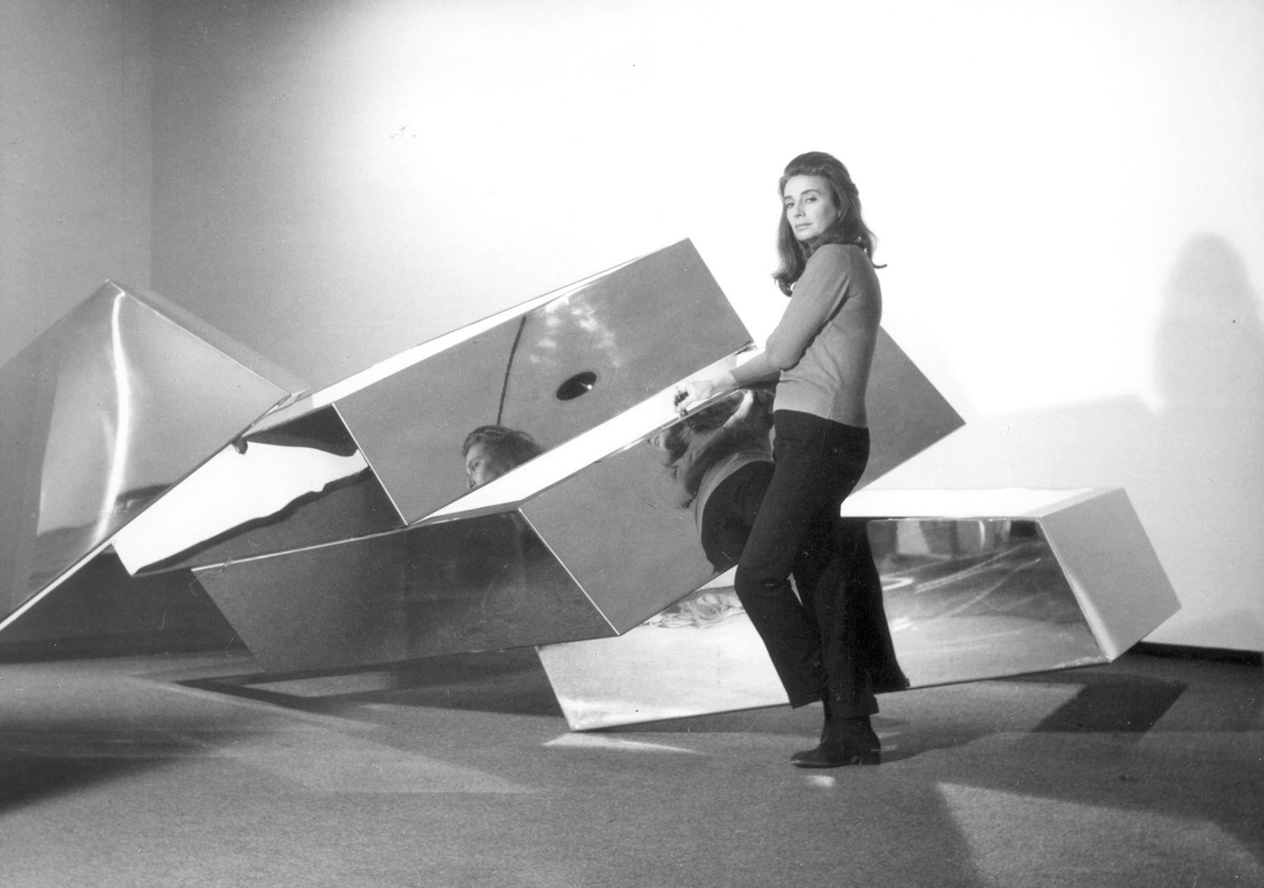 Portrait of Beverly Pepper with her work, Fallen Sky, 1968