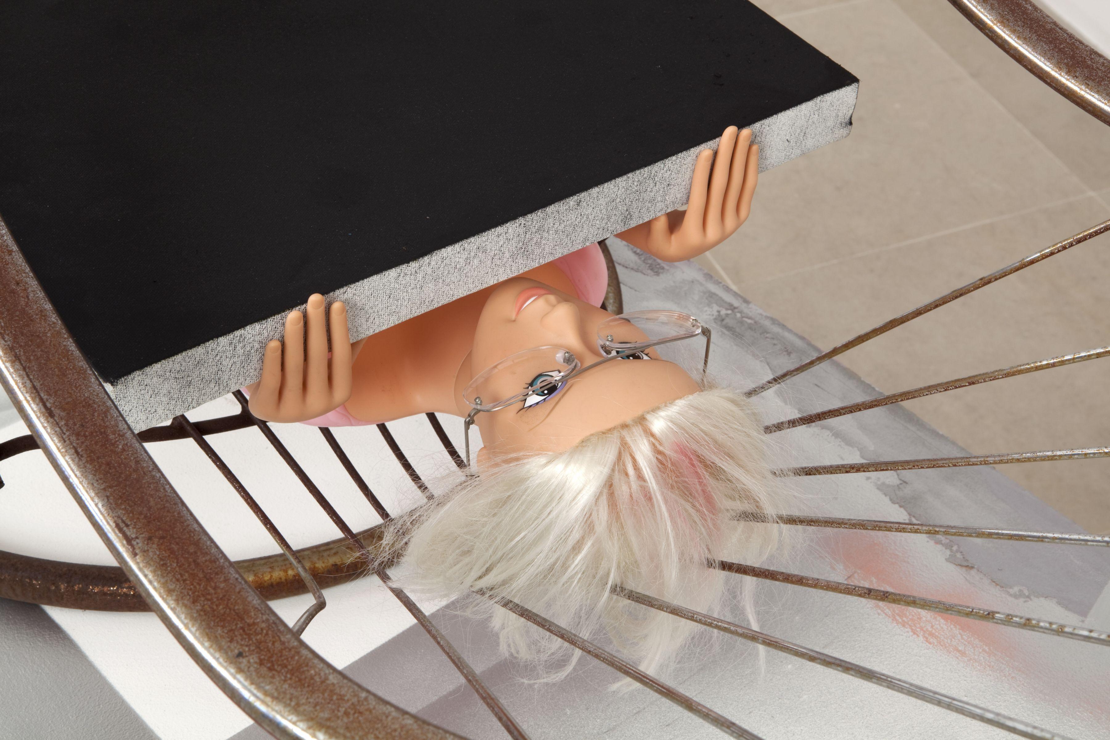 Rachel Harrison The Spoonbender, 2011 Wood, polystyrene, cement, acrylic, felt, canvas, steel chair, plastic doll and eyeglasses 53 1/2 x 59 x 77 inches (135.9 x 149.9 x 195.6 cm)
