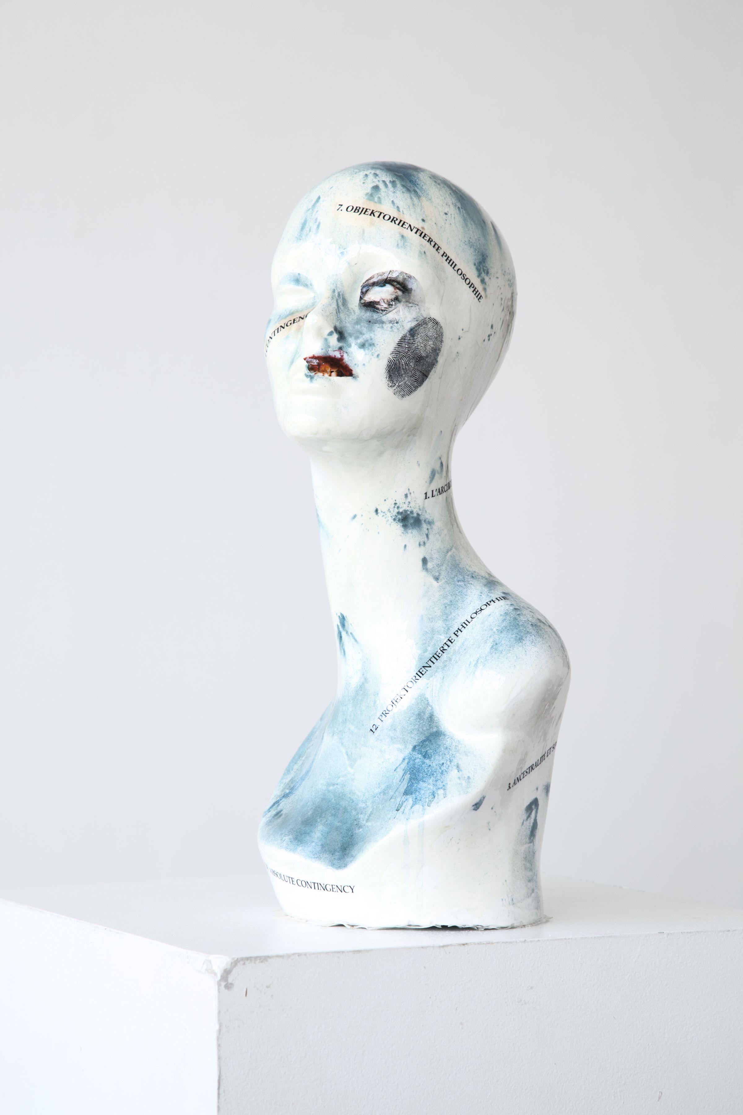 Mathieu Malouf  Slave (Object-Oriented Philosophy), 2012  Decals, enamel, spirulina powder, epoxy resin on heads  19 x 8 1/2 x 8 1/4 inches (48.3 x 21.6 x 21 cm)