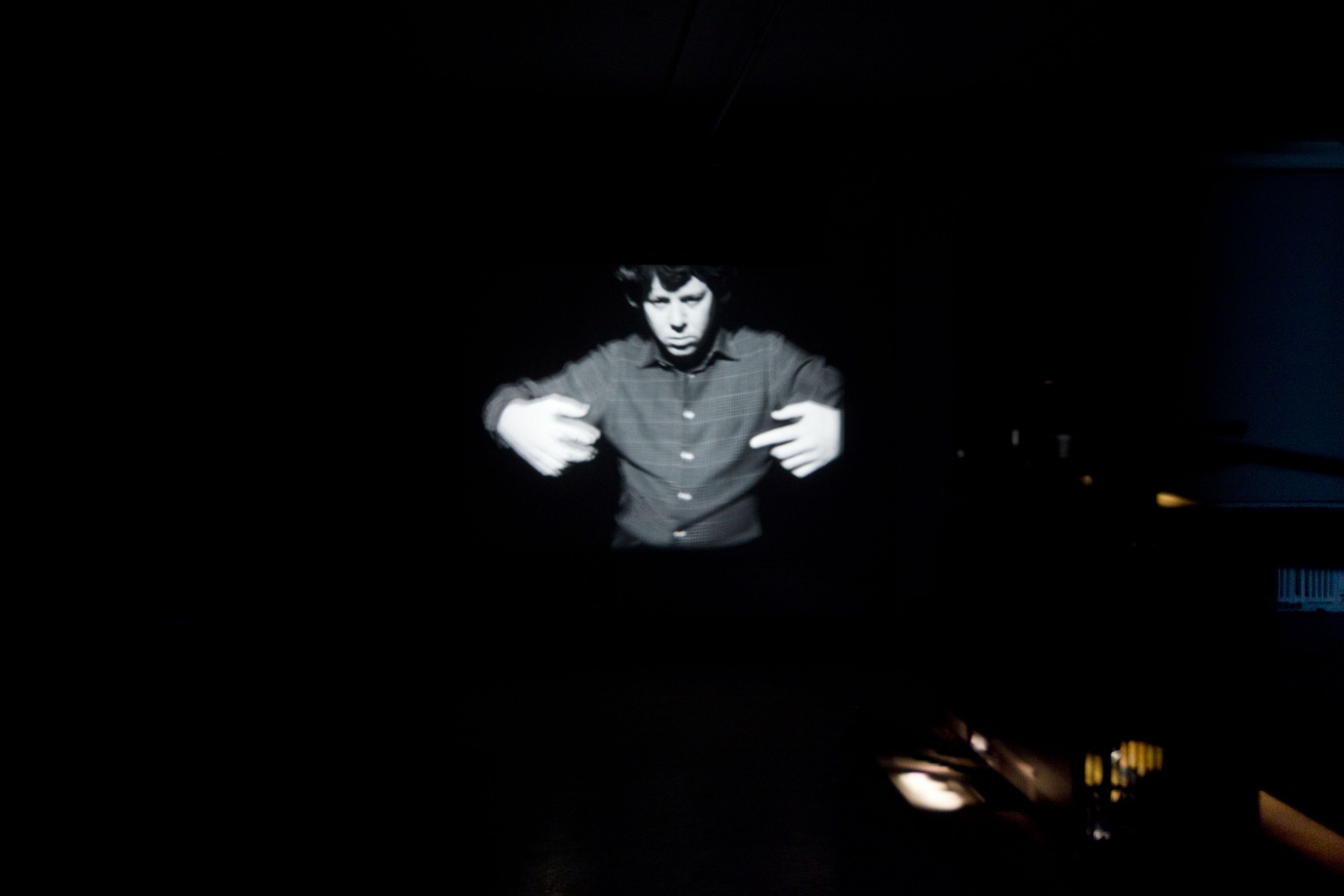 To navigate, in a genuine way, in the unknown necessitates an attitude of daring, but not one of recklessness (movements generated from the Magical Passes of Carlos Castaneda), 2009, 16mm black and white film, 3:30 minutes, continuous loop, Installation view, Greene Naftali, New York, 2010