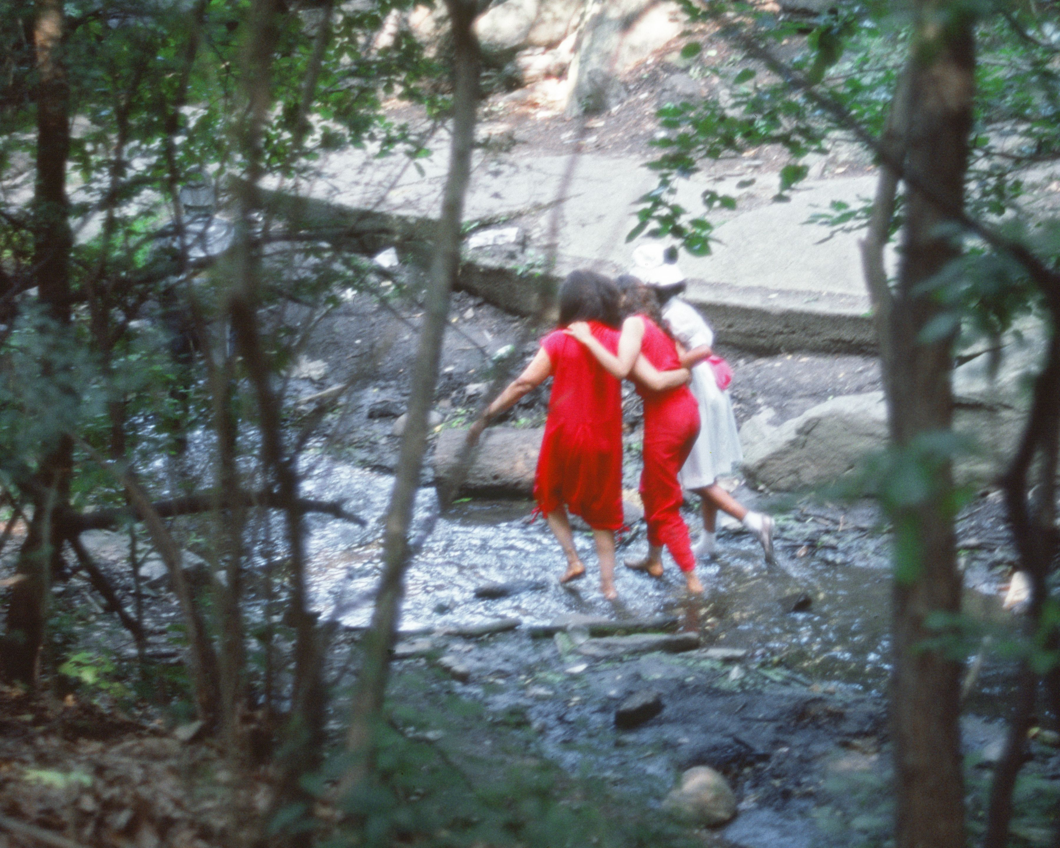 Rivers, First Draft: The Woman in Red, the Teenager in Magenta, and the Little Girl in Pink Sash wade the stream, 1982/2015, Digital C-print from Kodachrome 35mm slides in 48 parts, 16h x 20w in (40.64h x 50.80w cm)