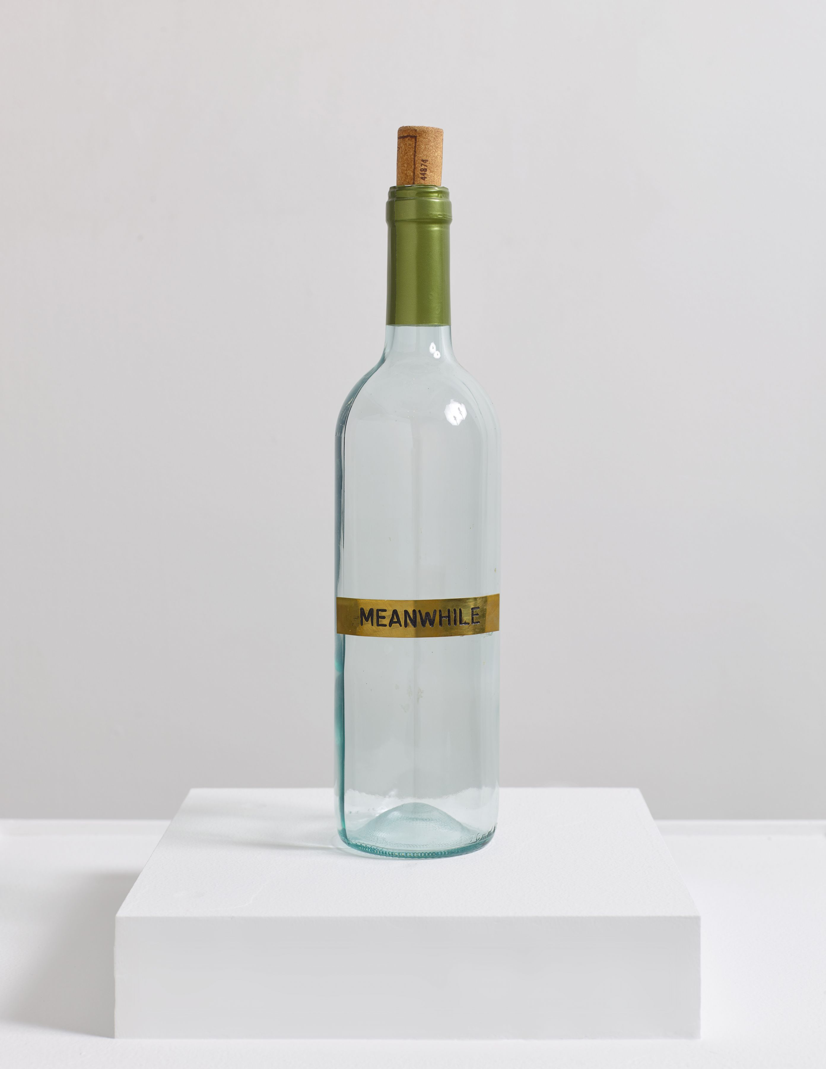 Meanwhile (2014) Glass, brass plaque, cork, and aluminum