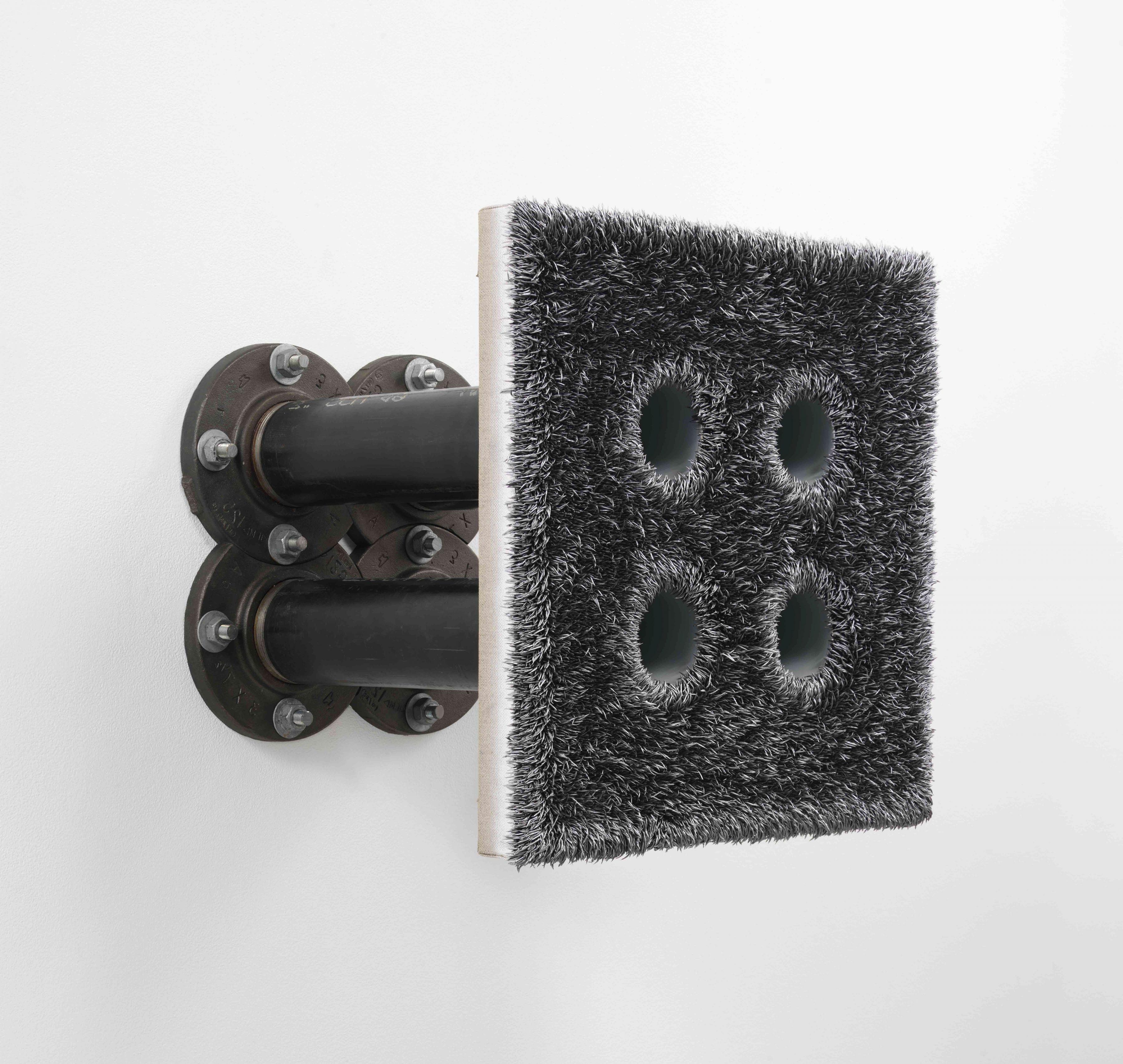 Extruded painting with four holes drilled in it attached to a wall with pipes by Donald Moffett