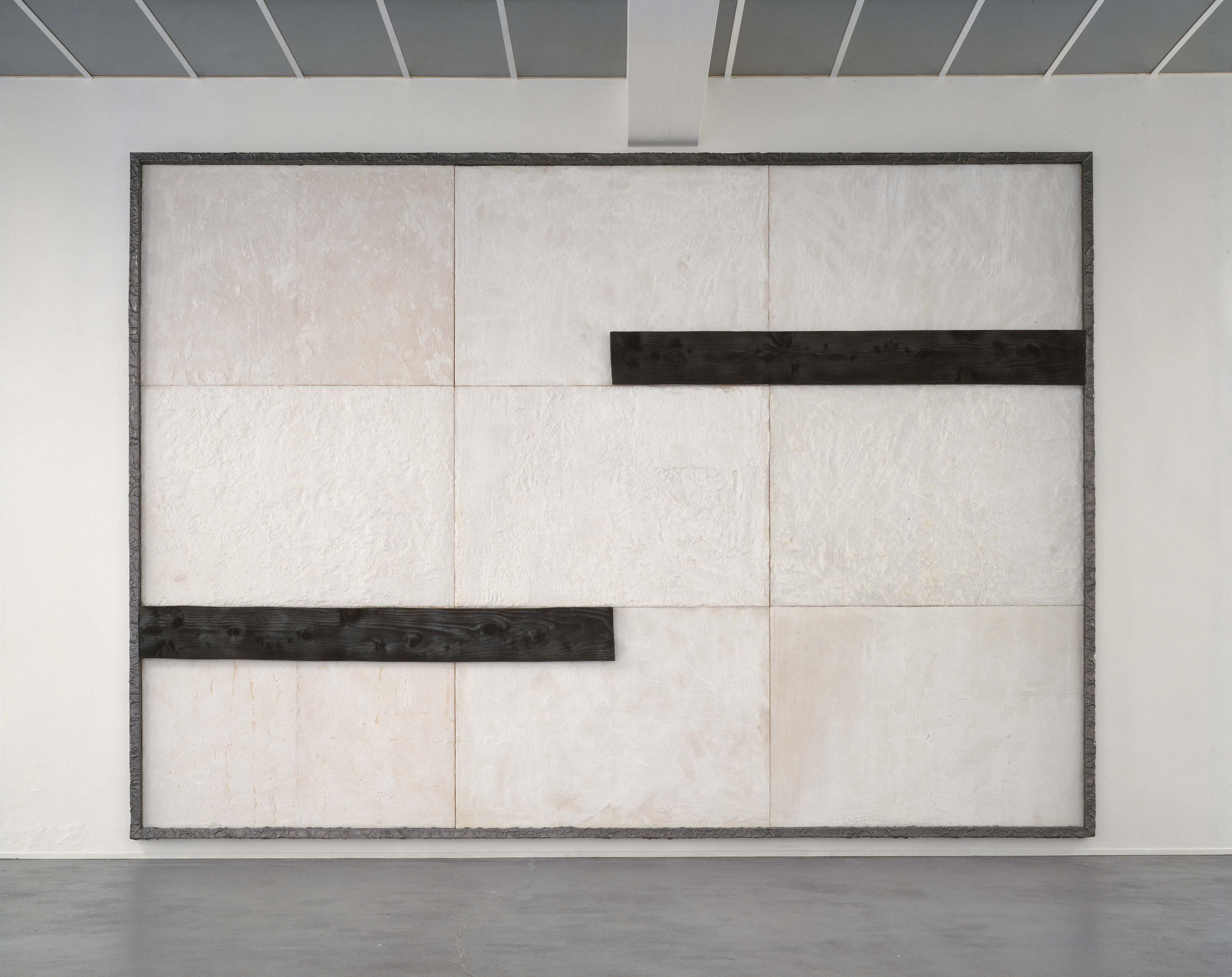 white and black grid painting made of wood, salt, and lead by pier paolo calzolari