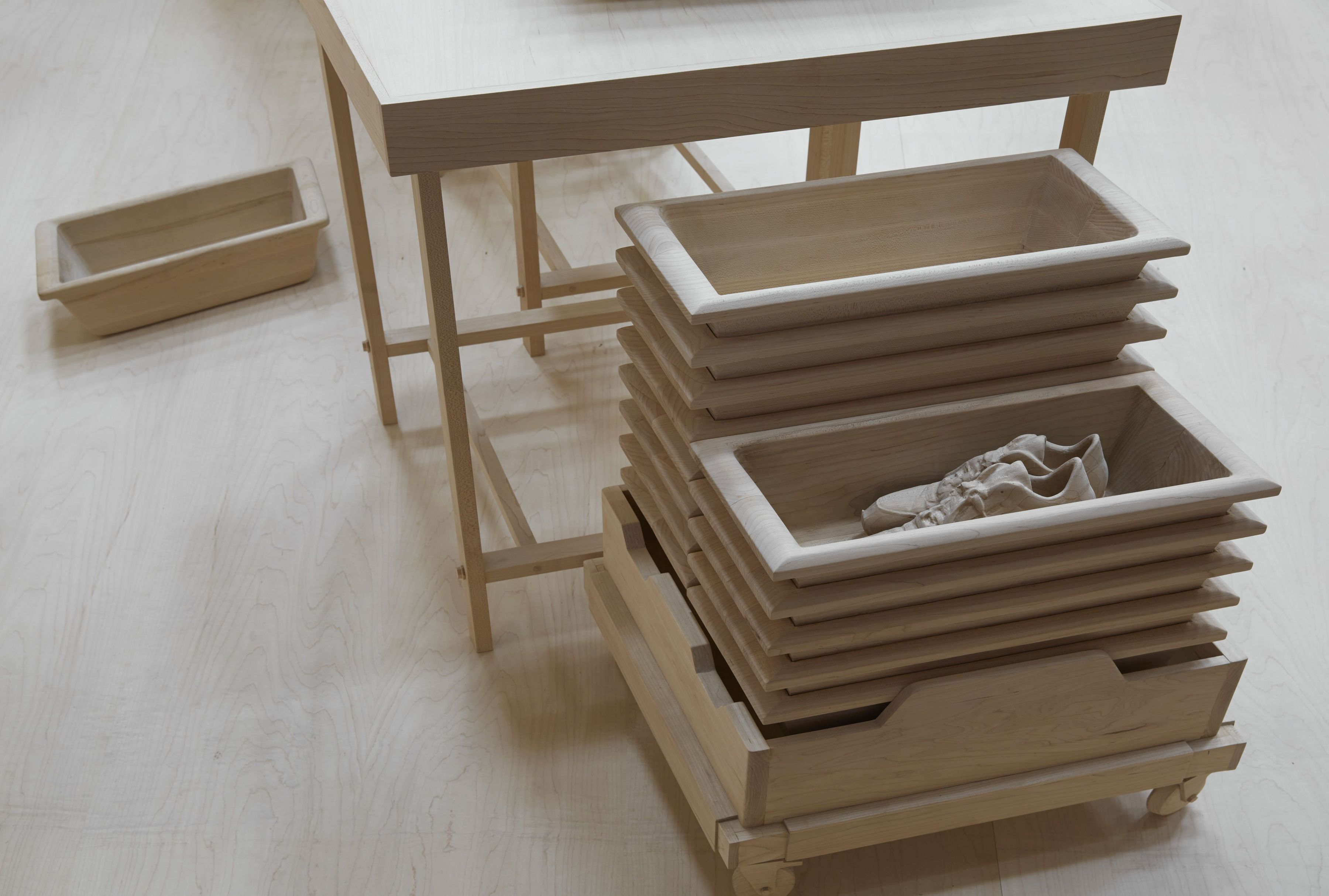 wood model of airport security bins by roxy paine