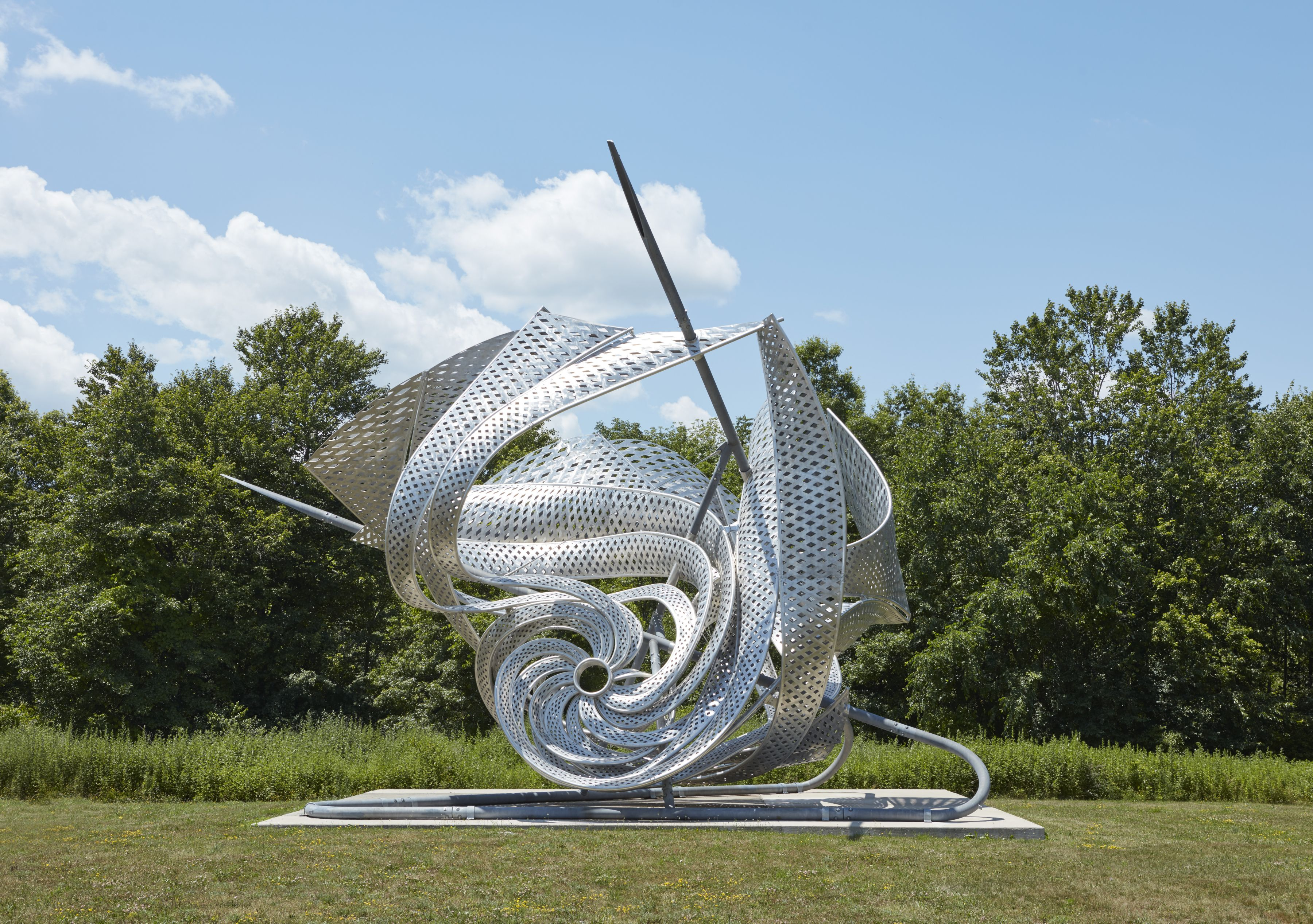 a twisted metal sculpture outdoors by frank stella