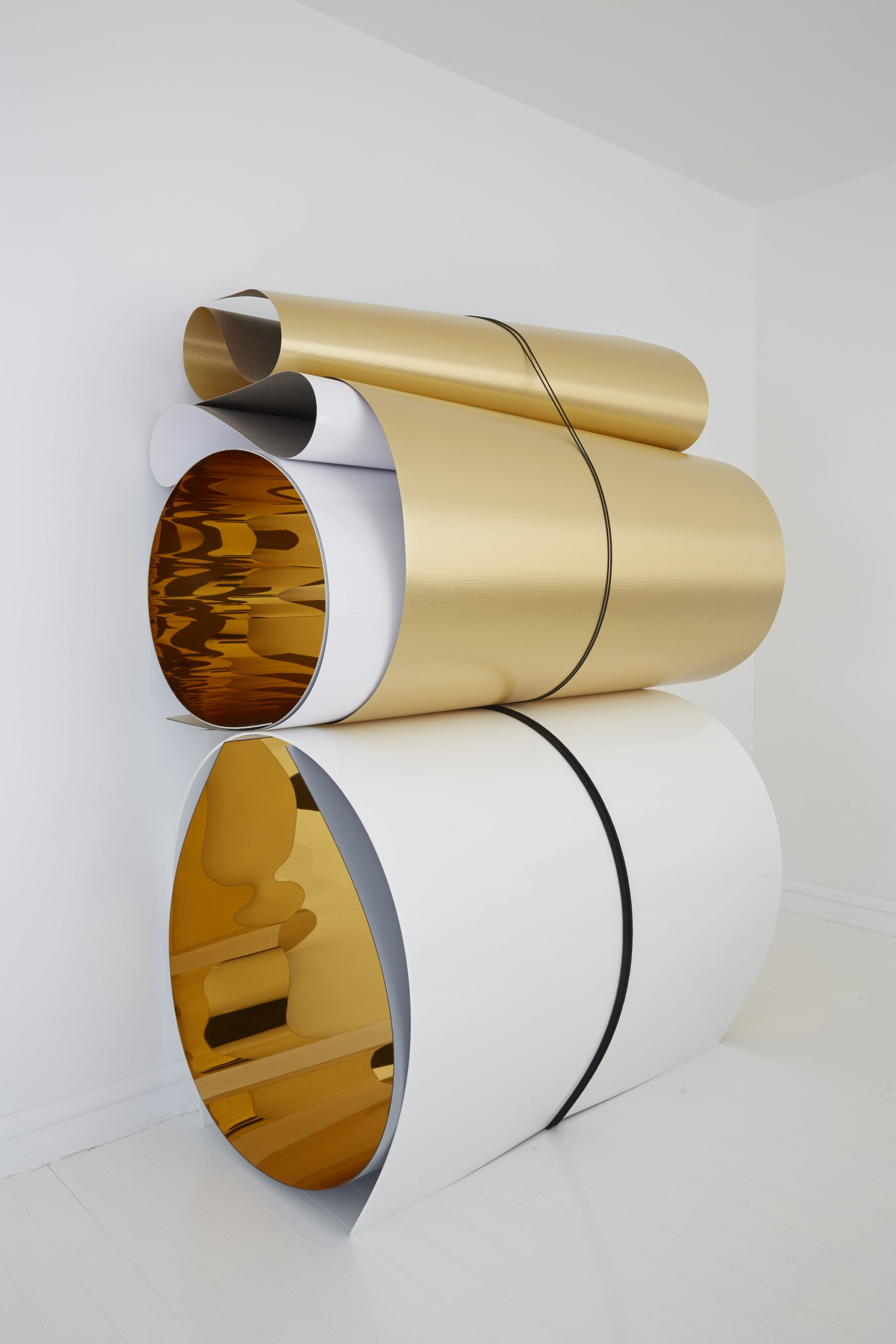 a sculpture of plexiglass and formica in rolls by Julia Dault