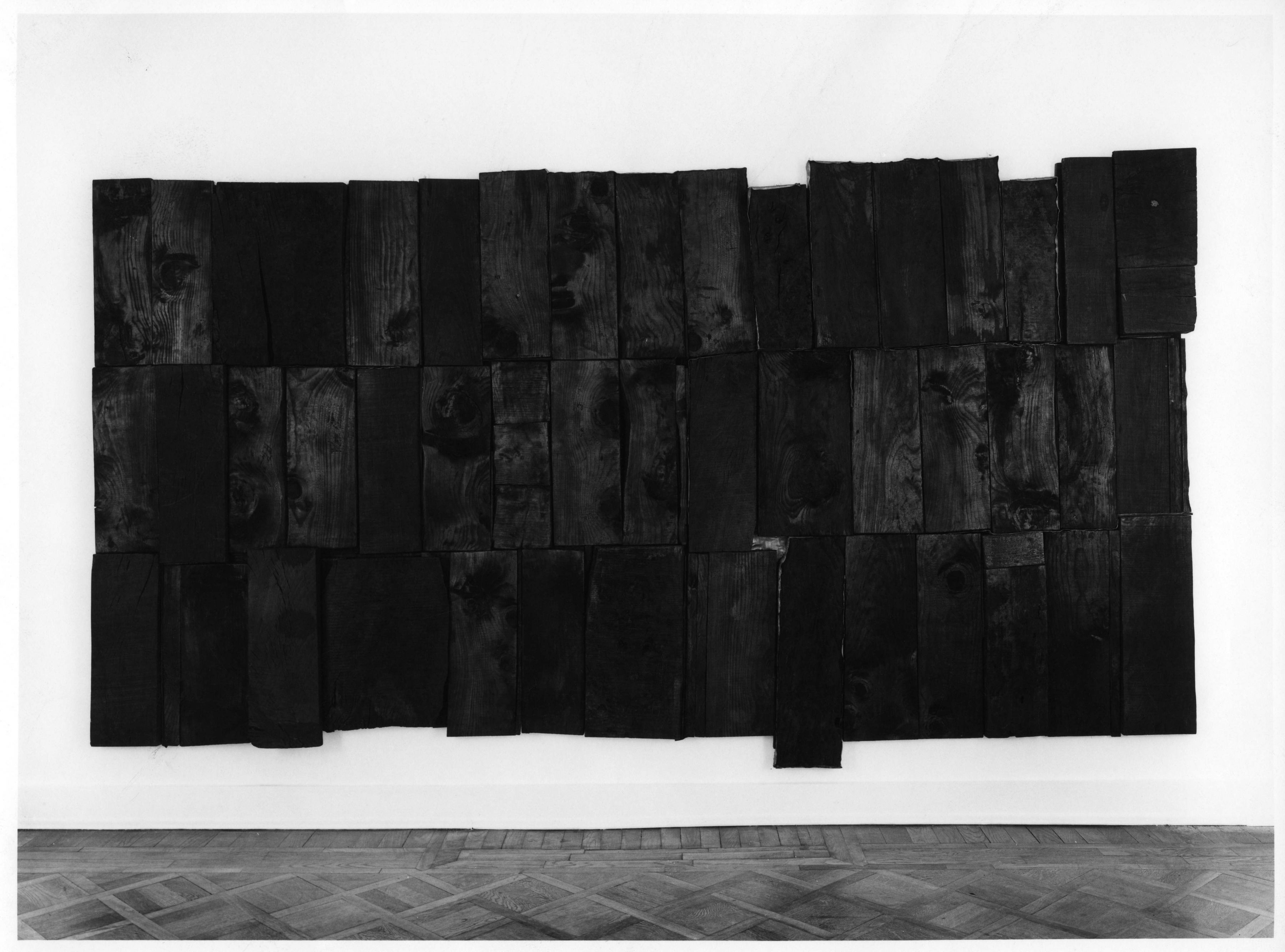 hung sculpture by pier paolo calzolari made of burnt wood panels